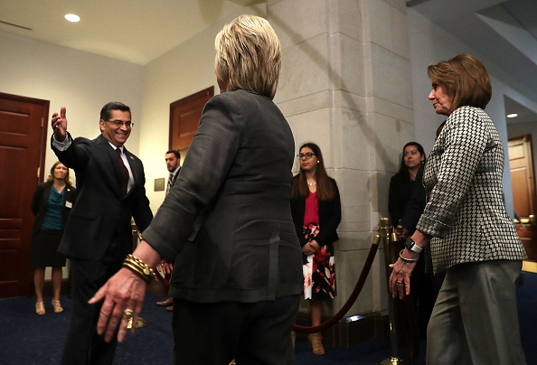 Democratic presidential candidate Hillary Clinton (C) is greeted by House Democratic Caucus Chair Xavier Becerra (D-CA) (L) as House Minority Leader Rep. Nancy Pelosi (D-CA) (R) looks on as she arrives to meet with House Democrats June 22, 2016 on Capitol Hill in Washington, DC.