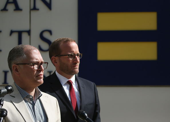 Plaintiff James Obergefell (L) is flanked by Human Rights Campaign President Chad Griffin (R), speaks about his case before tomorrow's arguments at the US Supreme Court April 27, 2015 in Washington, DC.