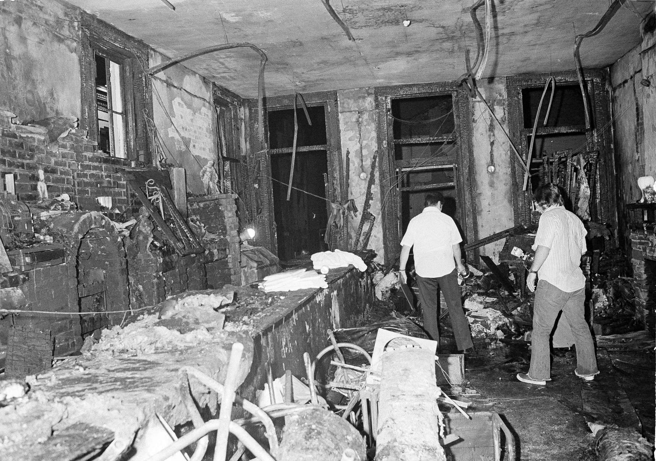 This is a view inside the UpStairs bar following a flash fire that left 29 dead and 15 injured, June 25, 1973. Most of the victims were found near the windows in the background. The bar is located in the New Orleans French Quarter.