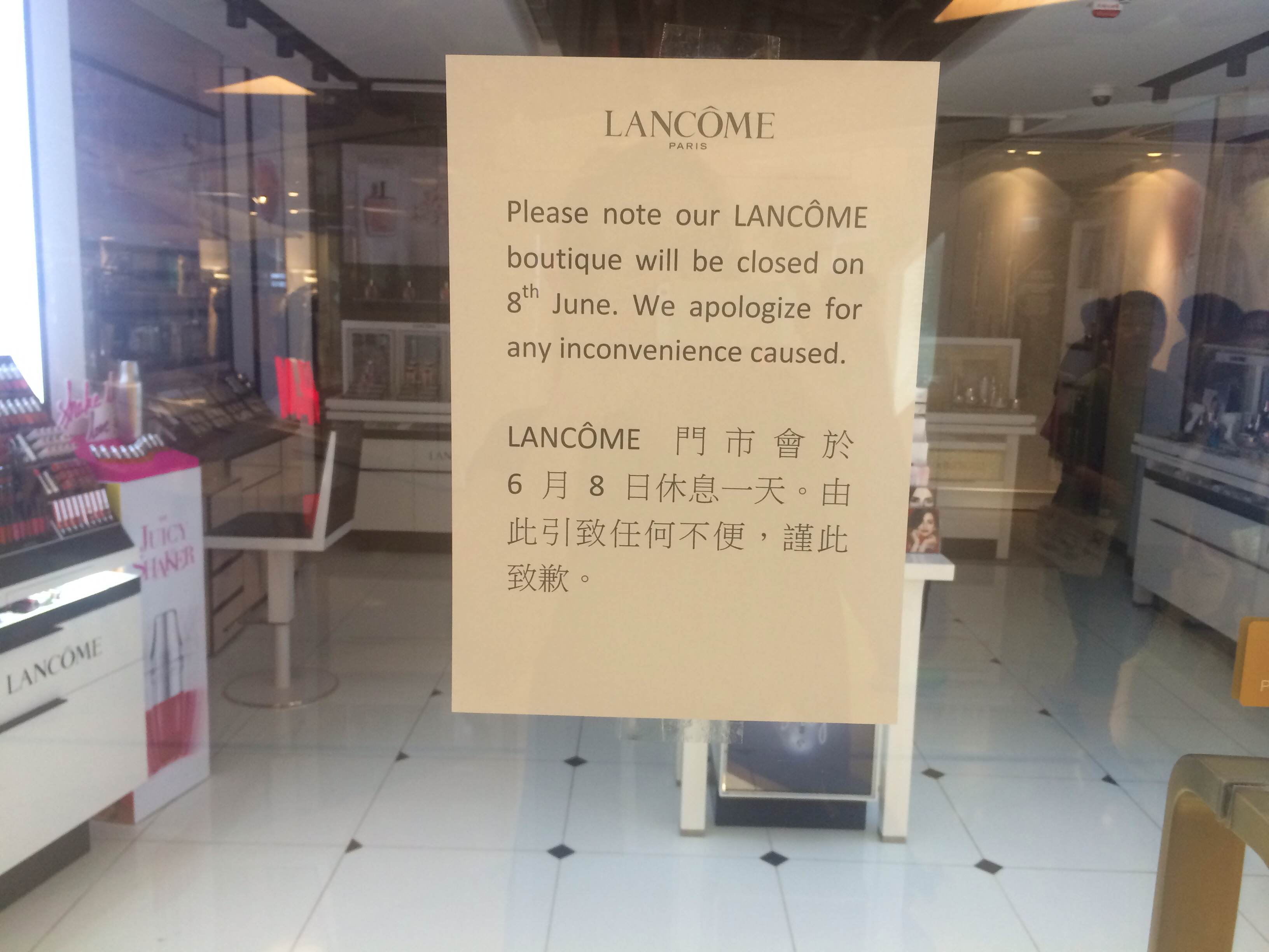 A sign on the store doors of Lancome at Cityplaza in Hong Kong advises customers that the store has been temporarily closed