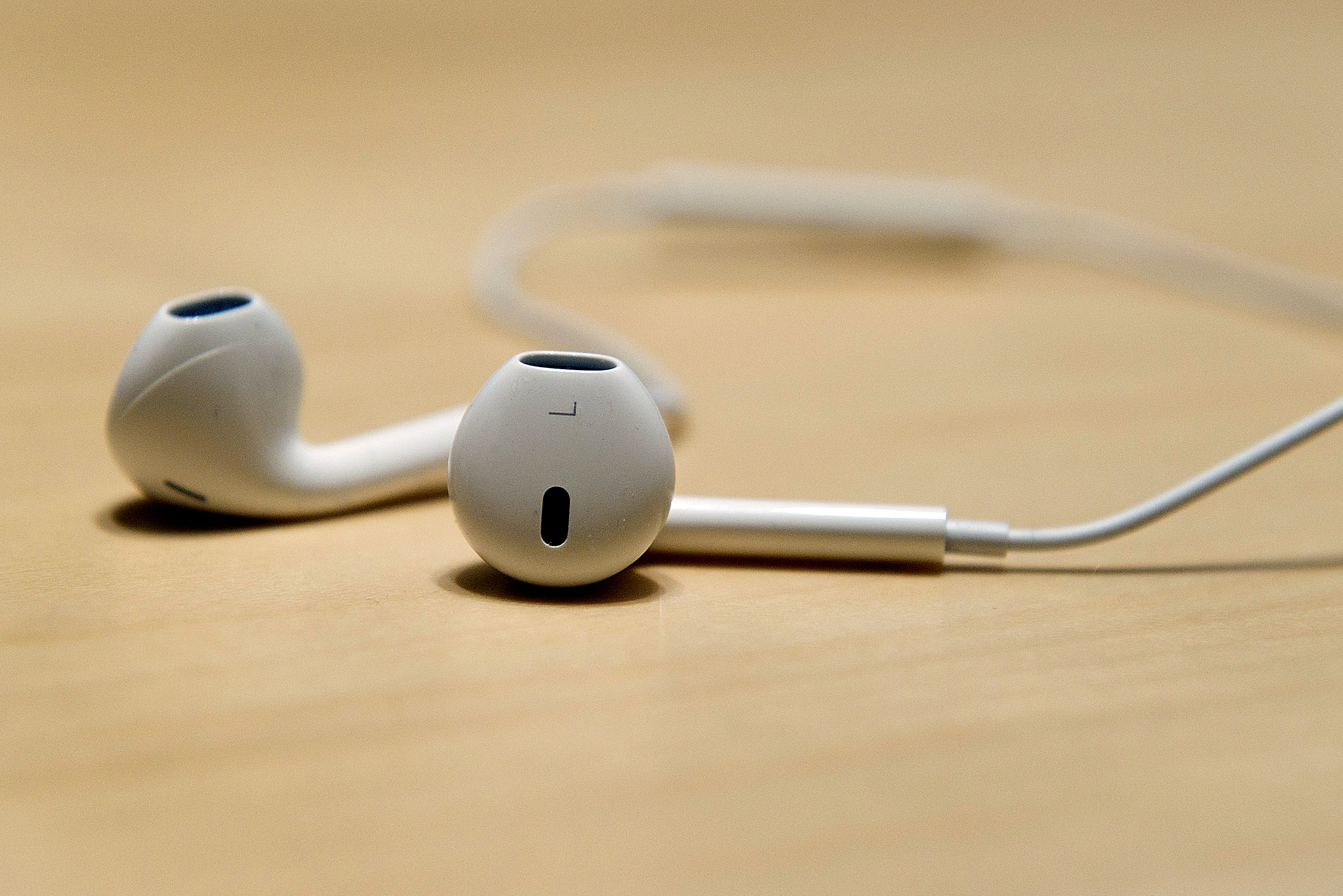 The new Apple Inc. earbuds are displayed for a photograph during an event in San Francisco, California, U.S., on Wednesday, Sept. 12, 2012. Apple Inc. unveiled the iPhone 5 in an overhaul aimed at widening its lead over Samsung Electronics Co. and Google Inc. in the $219.1 billion smartphone market.