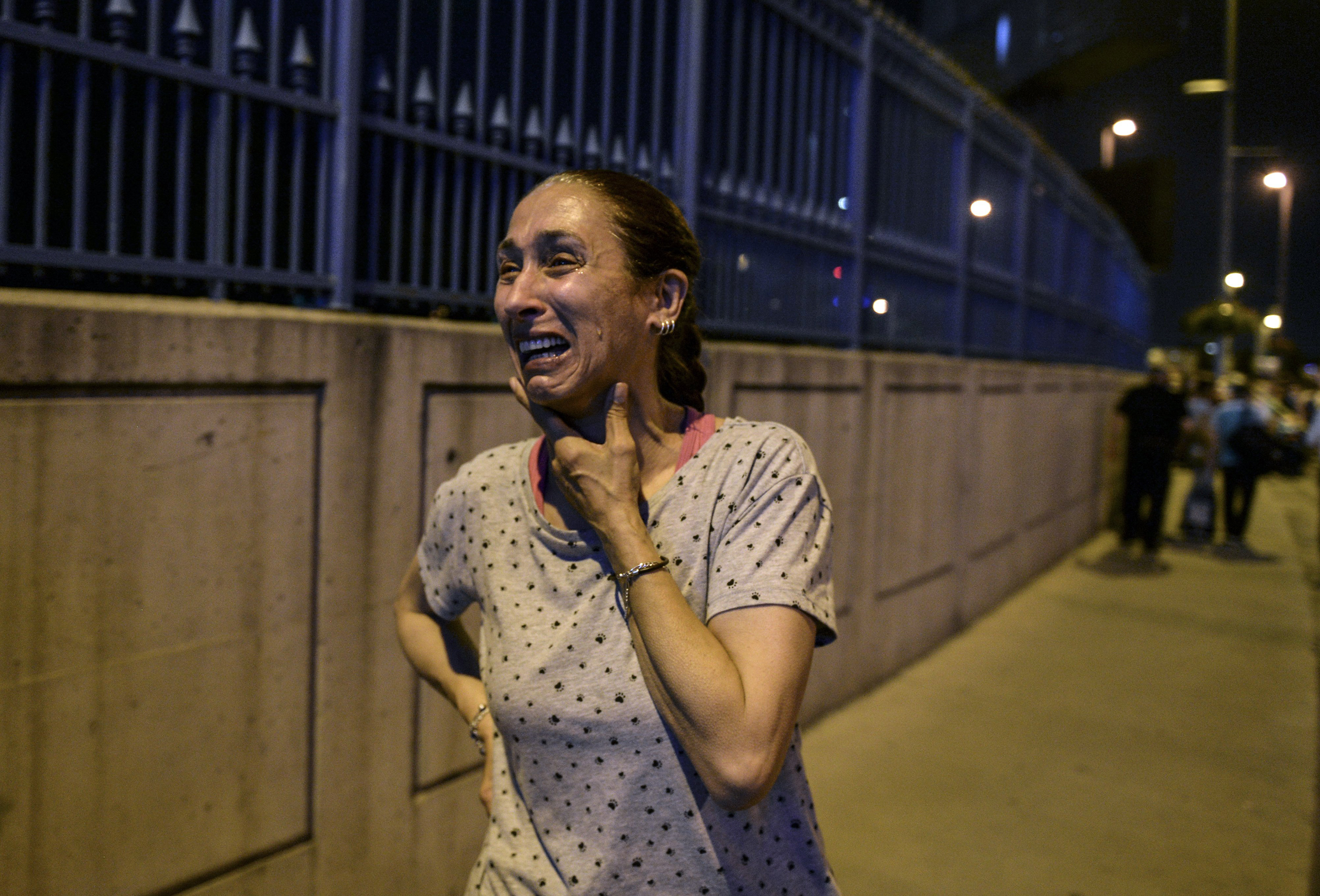 A woman cries outside Istanbul's Ataturk airport following an attack on June 28, 2016.