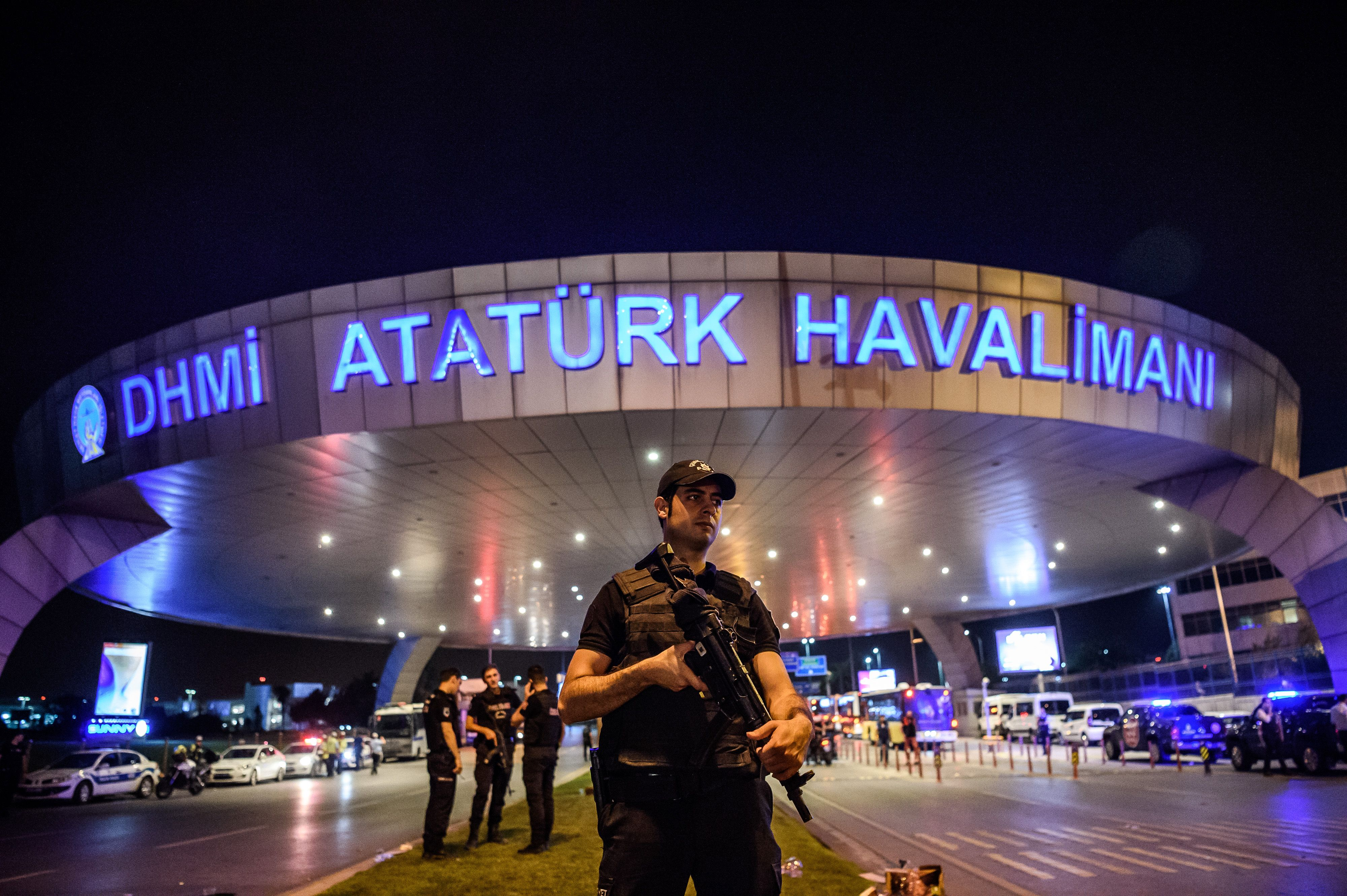A Turkish riot police officer patrols Ataturk airport's main enterance in Istanbul, on June 28, 2016.