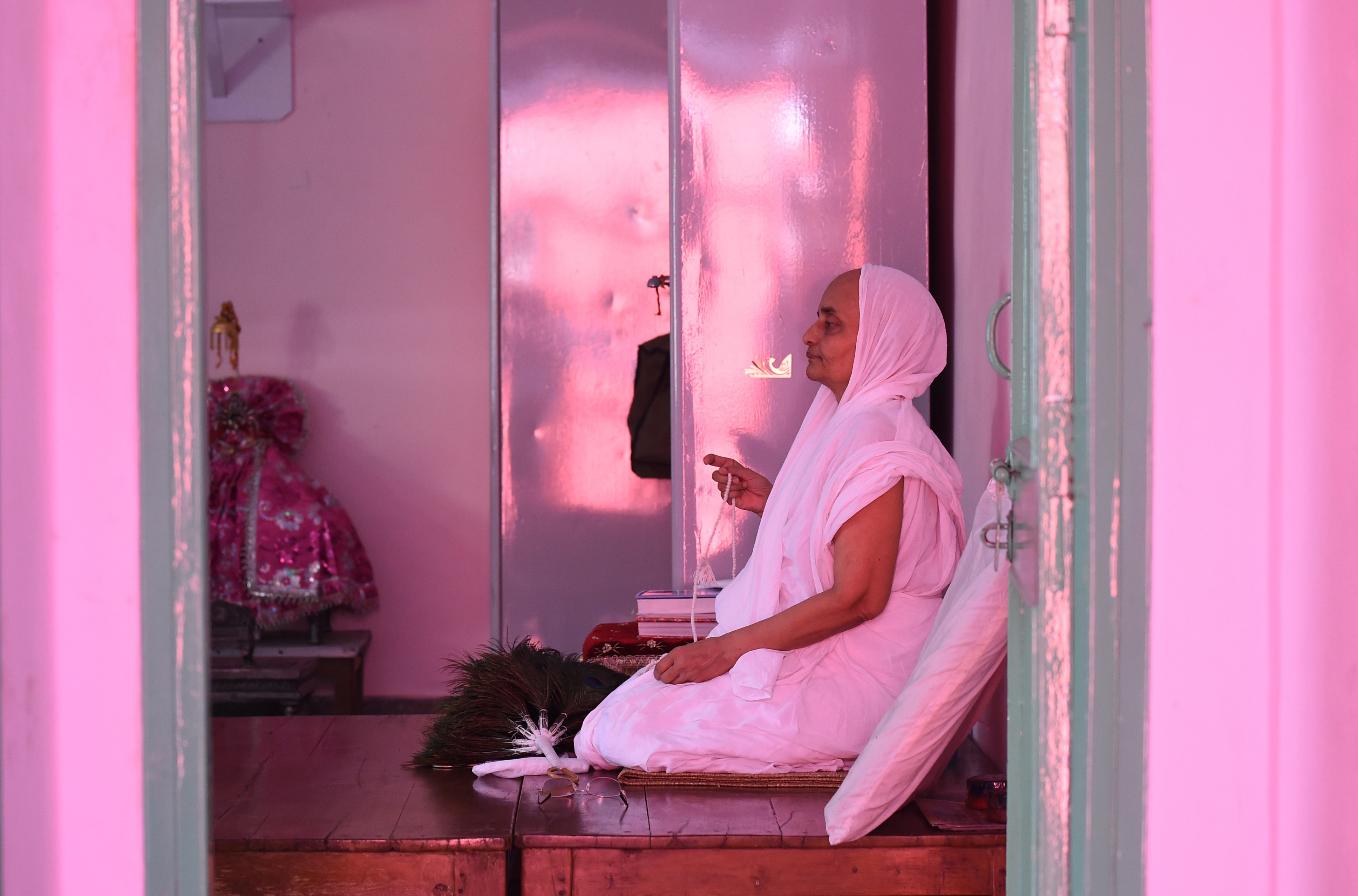 A Jain Sadhu (Jain Nun) prays in a room at the Jain Temple in the old quarters of New Delhi on August 31, 2015.