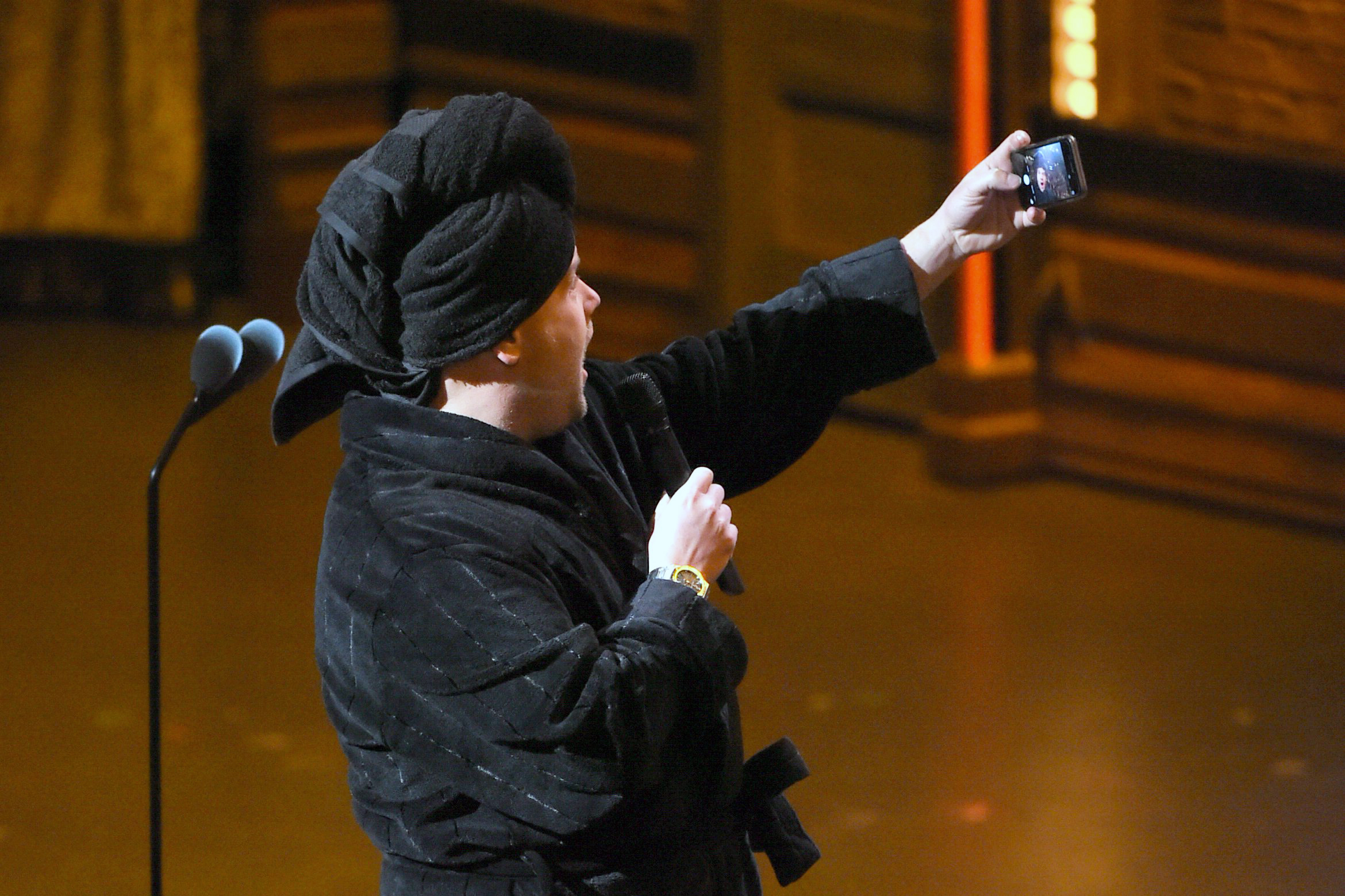 James Corden, wearing a bathrobe and slippers, takes a selfie during the pre-telecast portion of the Tony Awards at the Beacon Theatre on June 12, 2016, in New York.