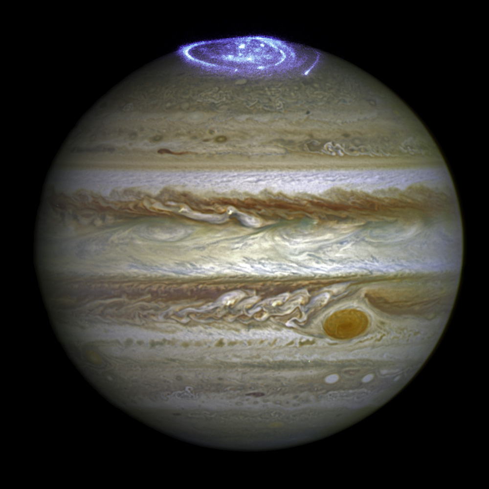 This image combines an image taken with Hubble Space Telescope in the optical (taken in spring 2014) and observations of its auroras in the ultraviolet, taken in 2016.