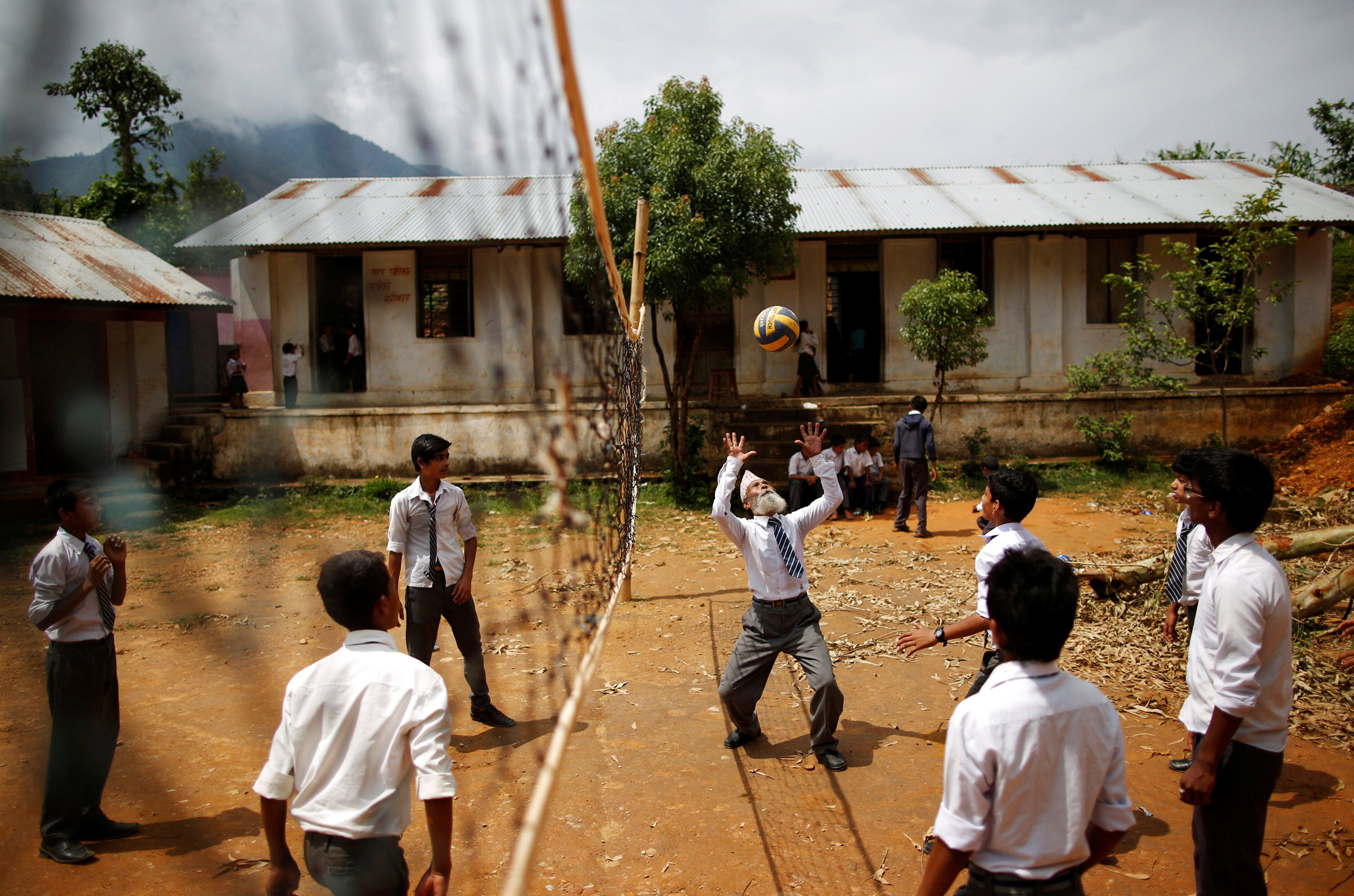 Durga Kami plays volleyball with schoolmates during a break in Syangja, Nepal, on June 5, 2016.