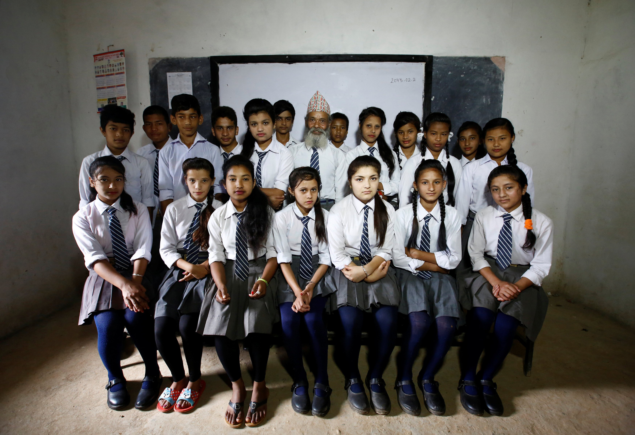 Durga Kami and his classmates pose for a group picture in their classroom at Shree Kala Bhairab Higher Secondary School in Syangja, Nepal, on June 5, 2016.
