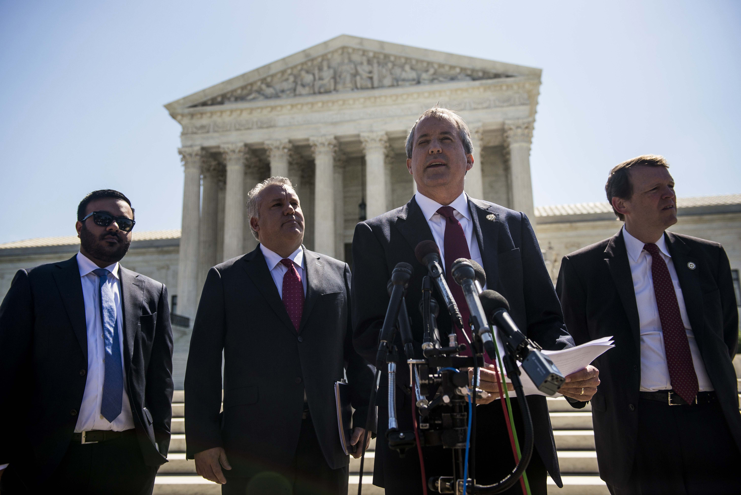 Texas Attorney General Ken Paxton speaks to reporters at a news conference outside the Supreme Court on Capitol Hill in Washington D.C. on June 9, 2016.