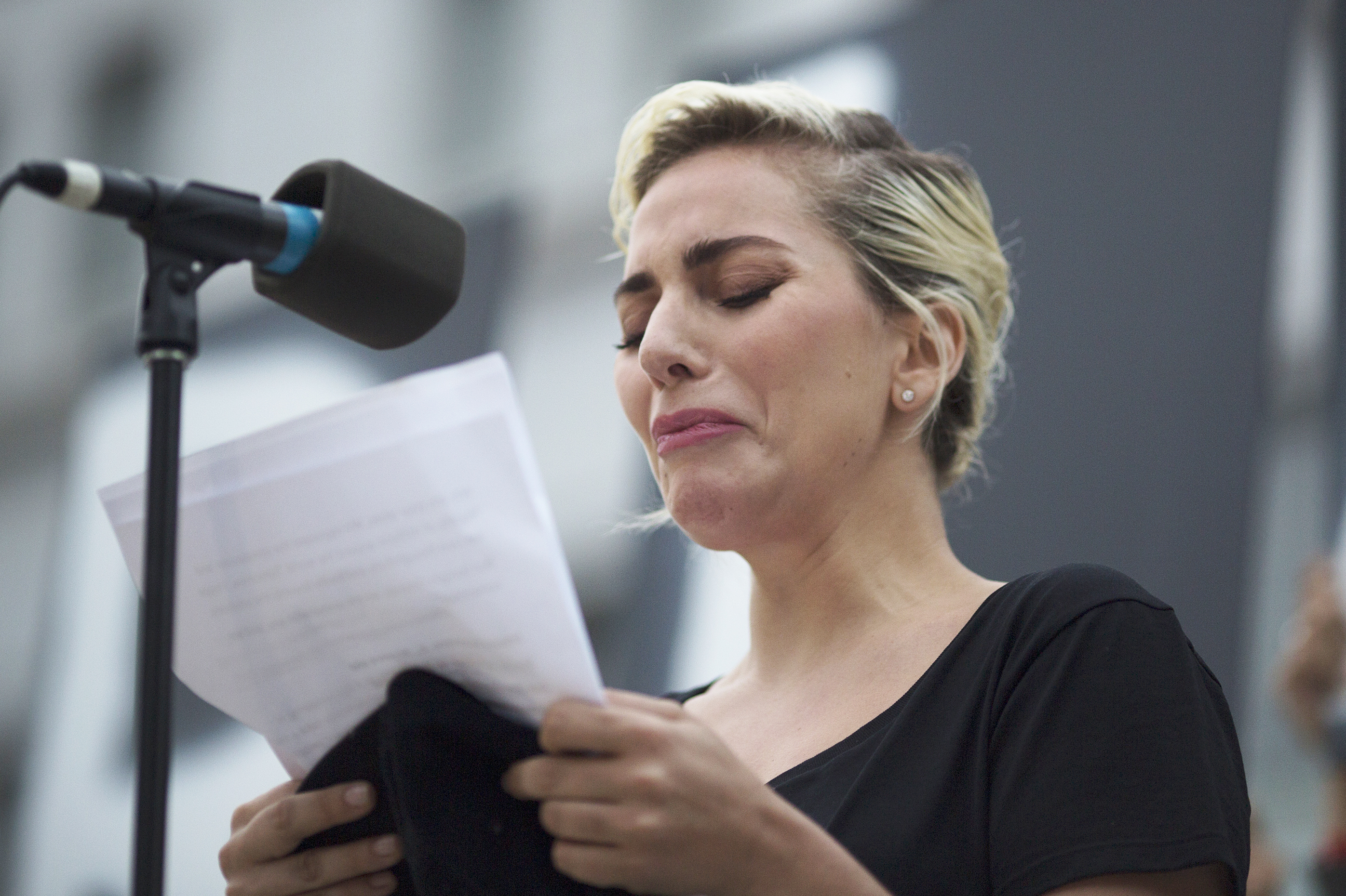 Lady Gaga reads some of the names of the victims of the Orlando shooting at a vigil on June 13, 2016 in Los Angeles.