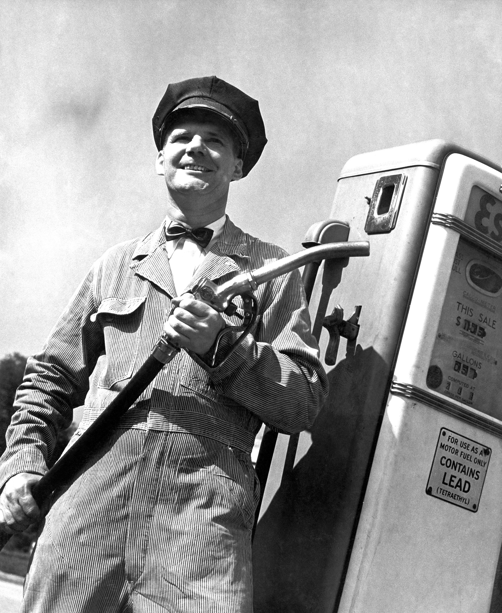A gas pump attendant at the ready with leaded gas, circa 1955.