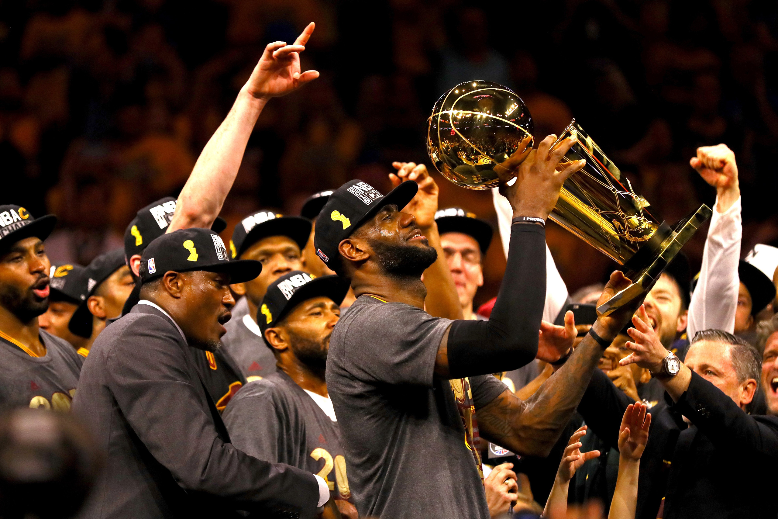 LeBron James #23 of the Cleveland Cavaliers holds the Larry O'Brien Championship Trophy after defeating the Golden State Warriors 93-89 in Game 7 of the 2016 NBA Finals at ORACLE Arena on June 19, 2016 in Oakland, California. NOTE TO USER: User expressly acknowledges and agrees that, by downloading and or using this photograph, User is consenting to the terms and conditions of the Getty Images License Agreement.  (Photo by Ezra Shaw/Getty Images)