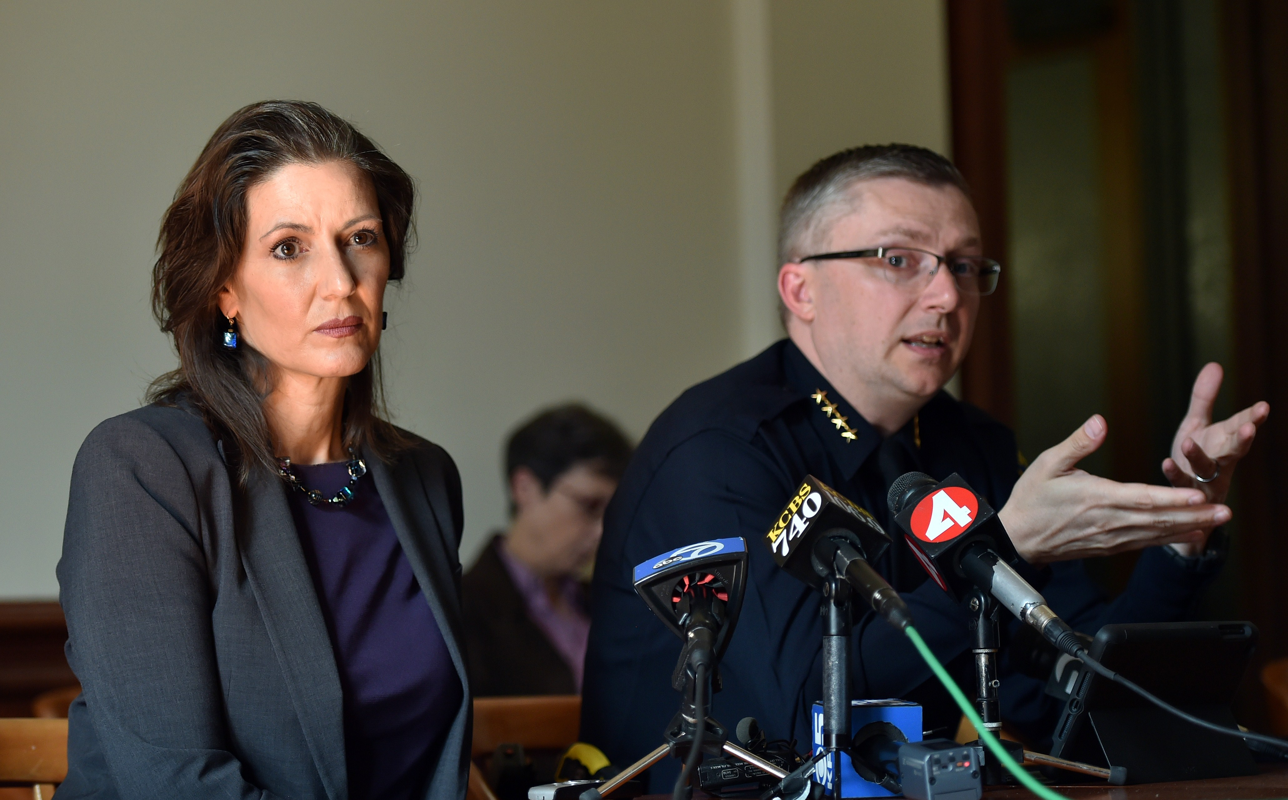 Oakland Mayor Libby Schaaf (L) and Oakland Police Chief Sean Whent (R) speak to members of the media about vandalism and property damage that ensued during a May Day protest in Oakland, California on May 2, 2015.
