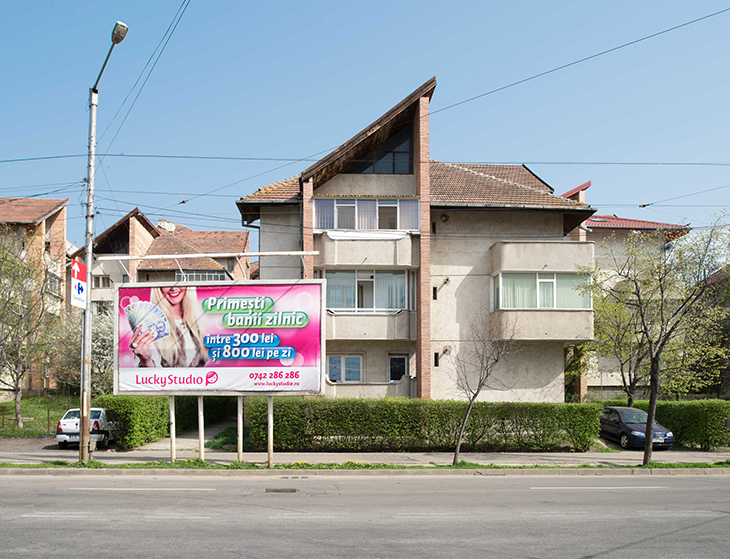 A Lucky Studio billboard shows daily earnings for models in Iași, northeastern Romania, April 2016.