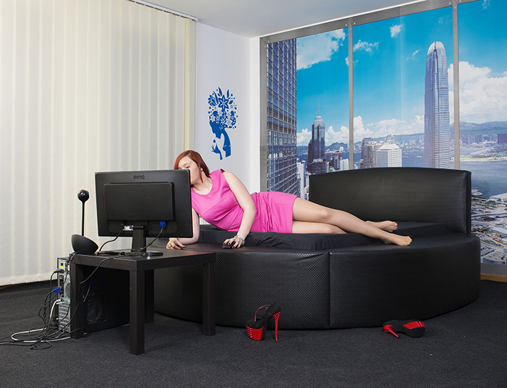 A cam model sets up before her day shift at Superstar Studio, Bucharest, Romania, March 2016.
