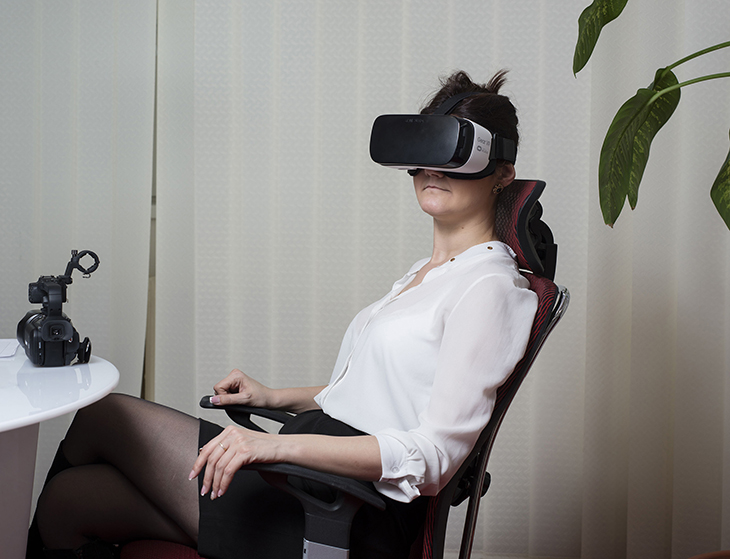 An operator in the office of the Studio 20 checks the work of a cam model in the virtual reality room, Bucharest, Romania, March 2016.