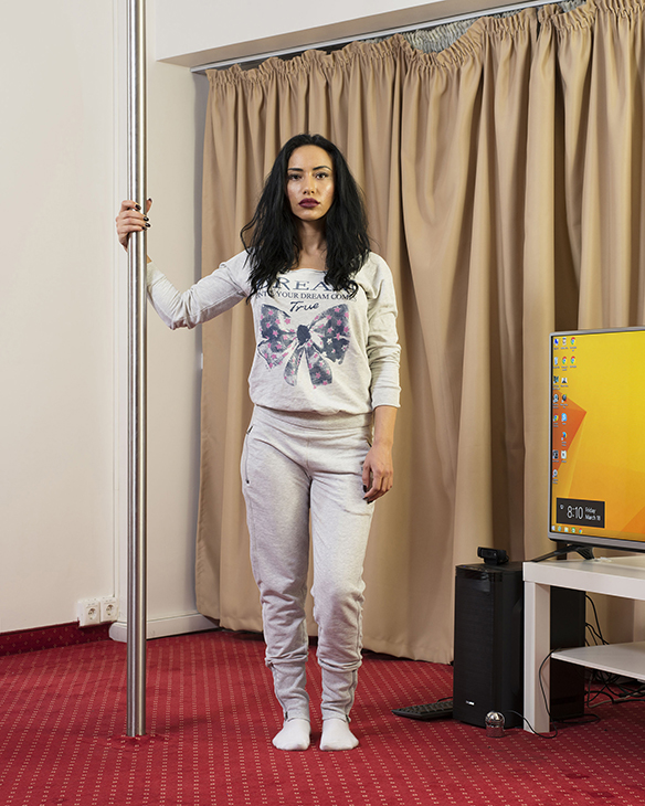 A 27-year-old cam model in a room of Studio 20 before her night shift, Bucharest, Romania, March 2016.