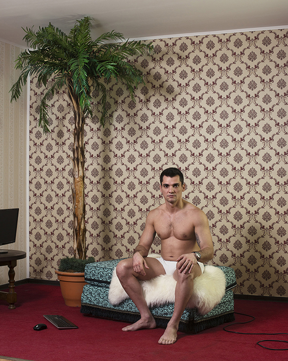 A 33-year-old cam model in a room at the studio after his day shift, Bucharest, Romania, April 2016.