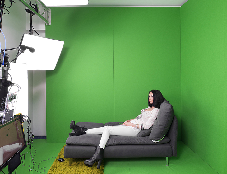 A 25-year-old cam model in the virtual reality room at Studio 20 before her night shift, Bucharest, Romania, March 2016.