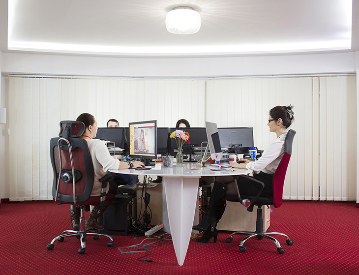 A group of operators at work in the office of Studio 20 in Bucharest, Romania, March 2016.