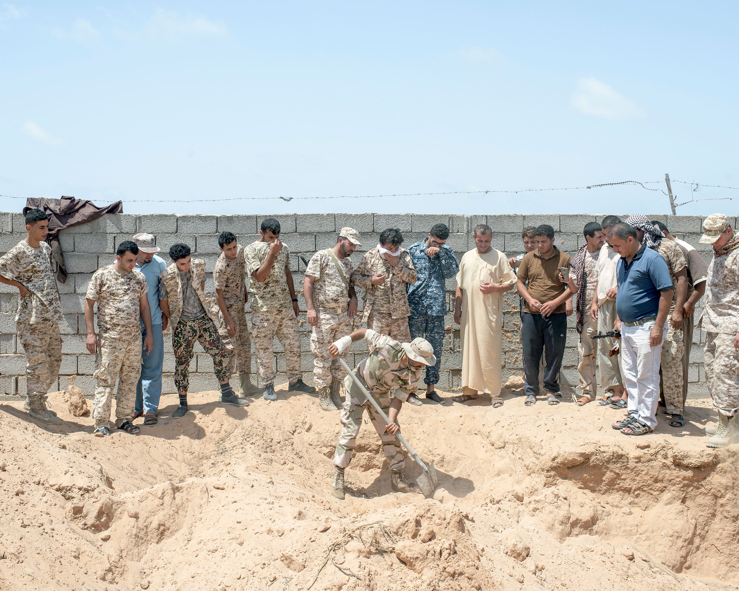 Libyan fighters unearth an ISIS mass grave, Sirt, Libya, July 2016.From  Inside ISIS' Last Bastion in Libya
