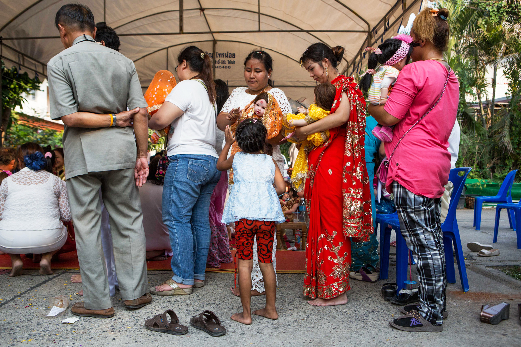 Attendees of Mama Ning's wai khru ceremony line up with their Luk Thep dolls for blessings in Bangkok on March 21, 2016.
