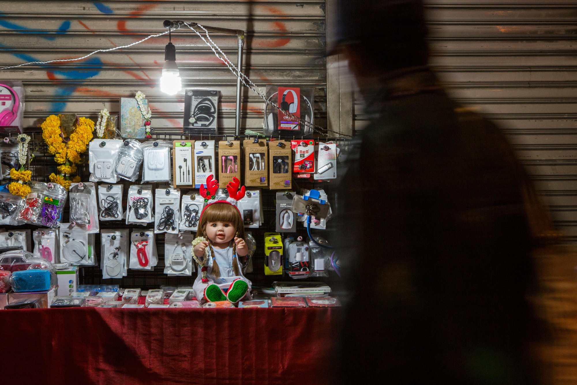 A Luk Thep doll dressed in a Christmas outfit is kept on a street stall by its owner to bring fortune to their business in Bangkok on Dec. 6, 2015.