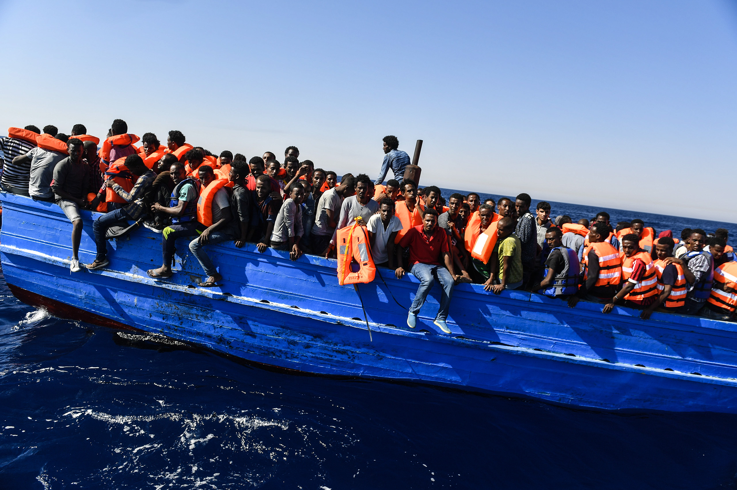 Hundreds of migrants wait to be rescued, as search-and-rescue teams circle the boat, off the coast of Libya, Aug. 21, 2016.From  Migrants' Last Hope: A Rescue on the Mediterranean Sea