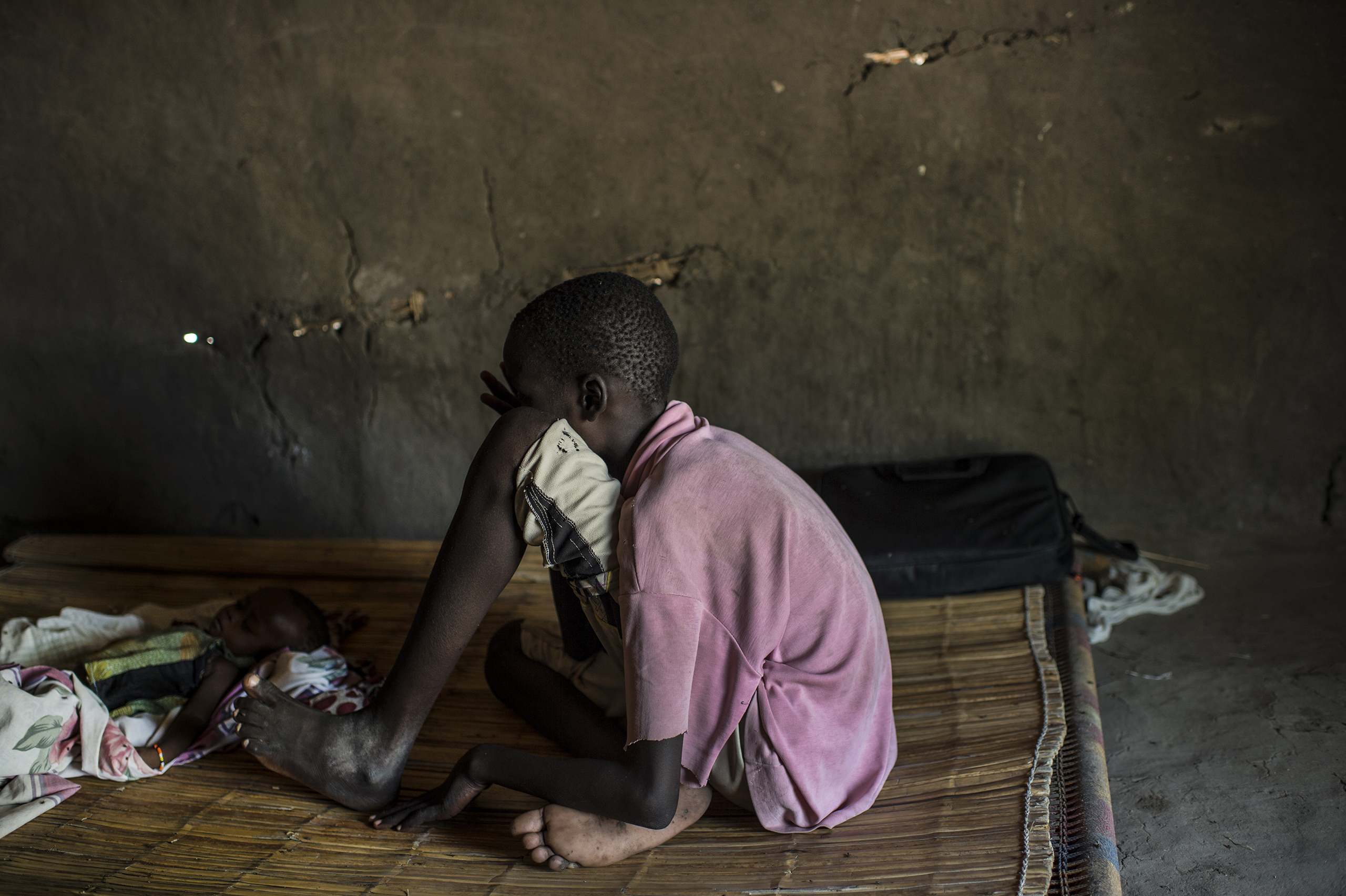 A South Sudanese boy in a safe house in Leer, in Unity State, South Sudan, March 19, 2016. He was the sole survivor of an October 2015 incident, during which government forces closed some 50 men in a shipping container for 36 hours until they suffocated.From  The Only One God Left Alive