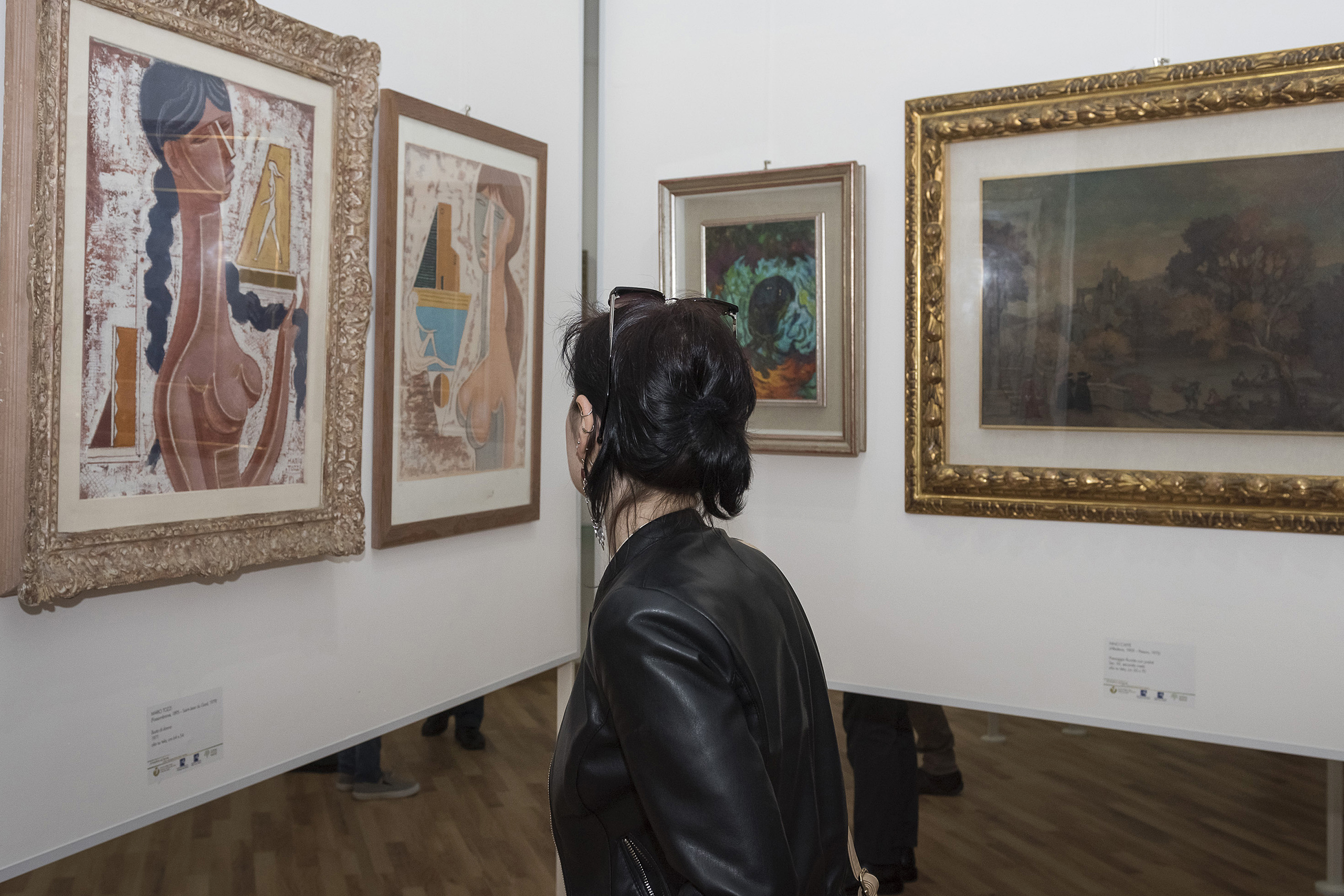 A visitor admires paintings during the  Victory of the State  exhibition in Reggio Calabria, Italy, on May 7, 2016. The exhibition includes paintings that belonged to a boss of the 'Ndrangheta Calabrese mafia, notably two of Dali, and were confiscated by the court.
