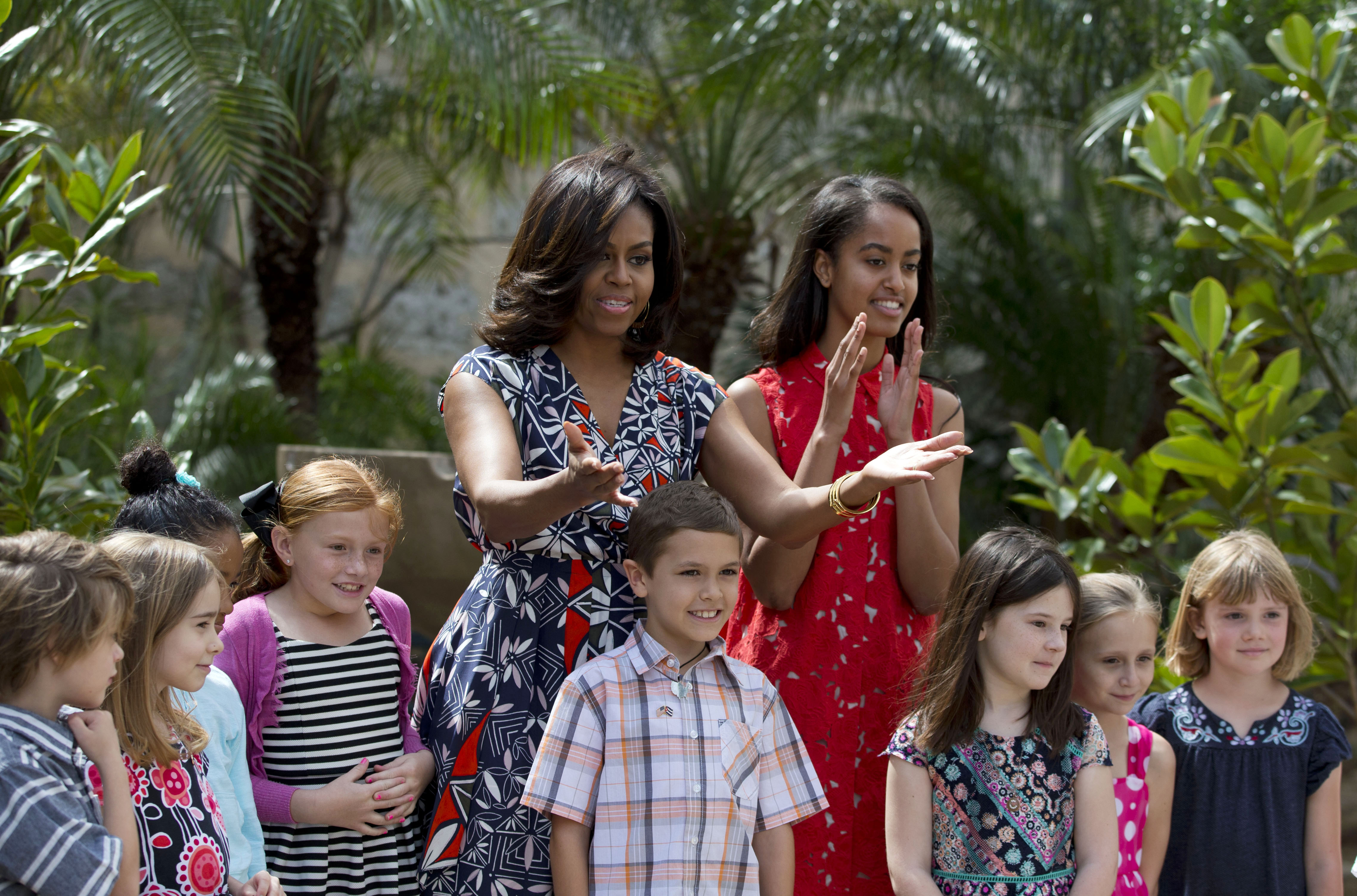 March 22, 2016                                First Lady Michelle Obama thanks embassy workers with her daughter Malia after dedicating two magnolia trees and a bench, at a small park  in Plaza de las Armas, Old Havana, Cuba.