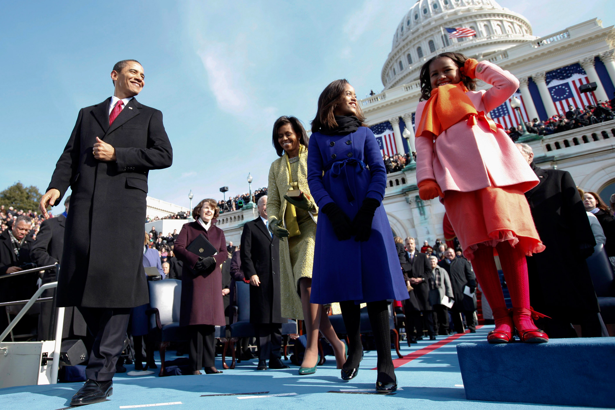 Malia Obama is graduating from the private Sidwell Friends School on Friday, growing up in the public eye of the White House.                                                              Jan. 20, 2009                                                              Then President-elect Barack Obama, his wife Michelle and daughters Sasha, right and Malia, on the podium moments before Obama was sworn in as the 44th president at the U.S. Capitol in Washington. Malia, 10, wore a double-breasted periwinkle-blue coat with a blue-ribbon bow at the waist from Crewcuts by J. Crew.