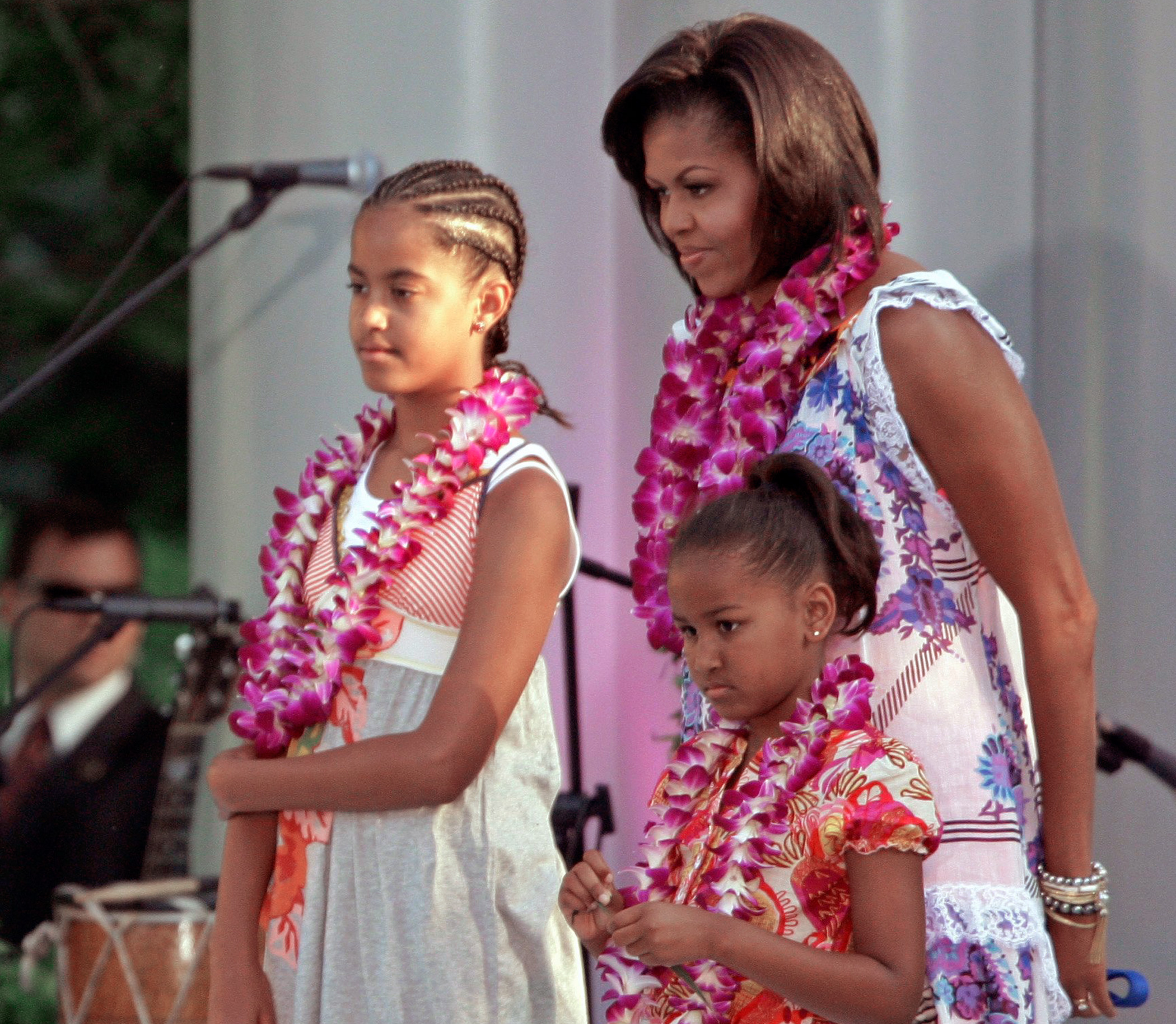June 25, 2009                                Malia Obama with mother Michelle and sister Sasha, attend a luau hosted by the president on the South Lawn of the White House for members of Congress and their families.