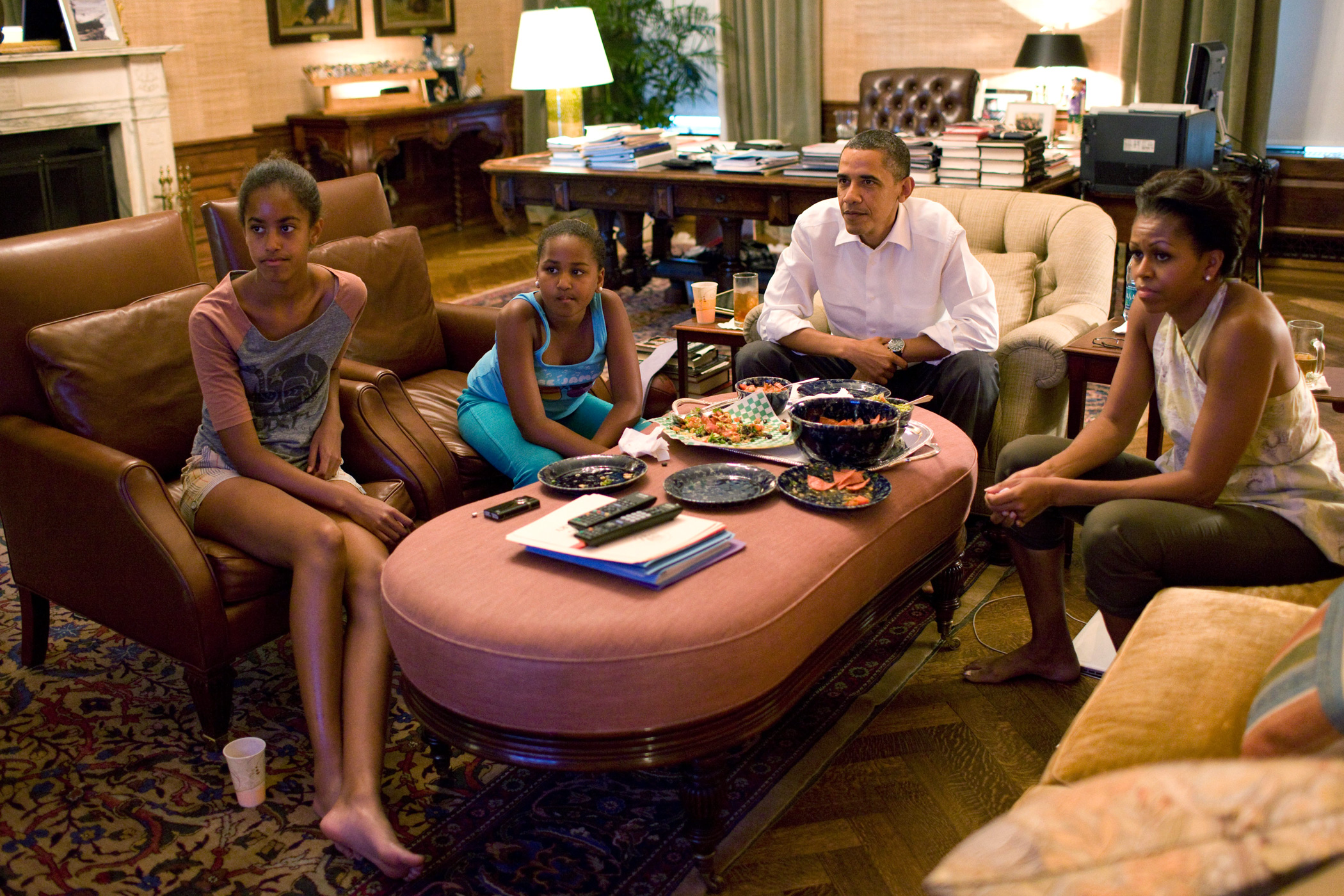 July 17, 2011                               In this handout provided by the White House, President Barack Obama and first lady Michelle Obama with their daughters Sasha and Malia watch a World Cup soccer match from the Treaty Room office in the residence of the White House.