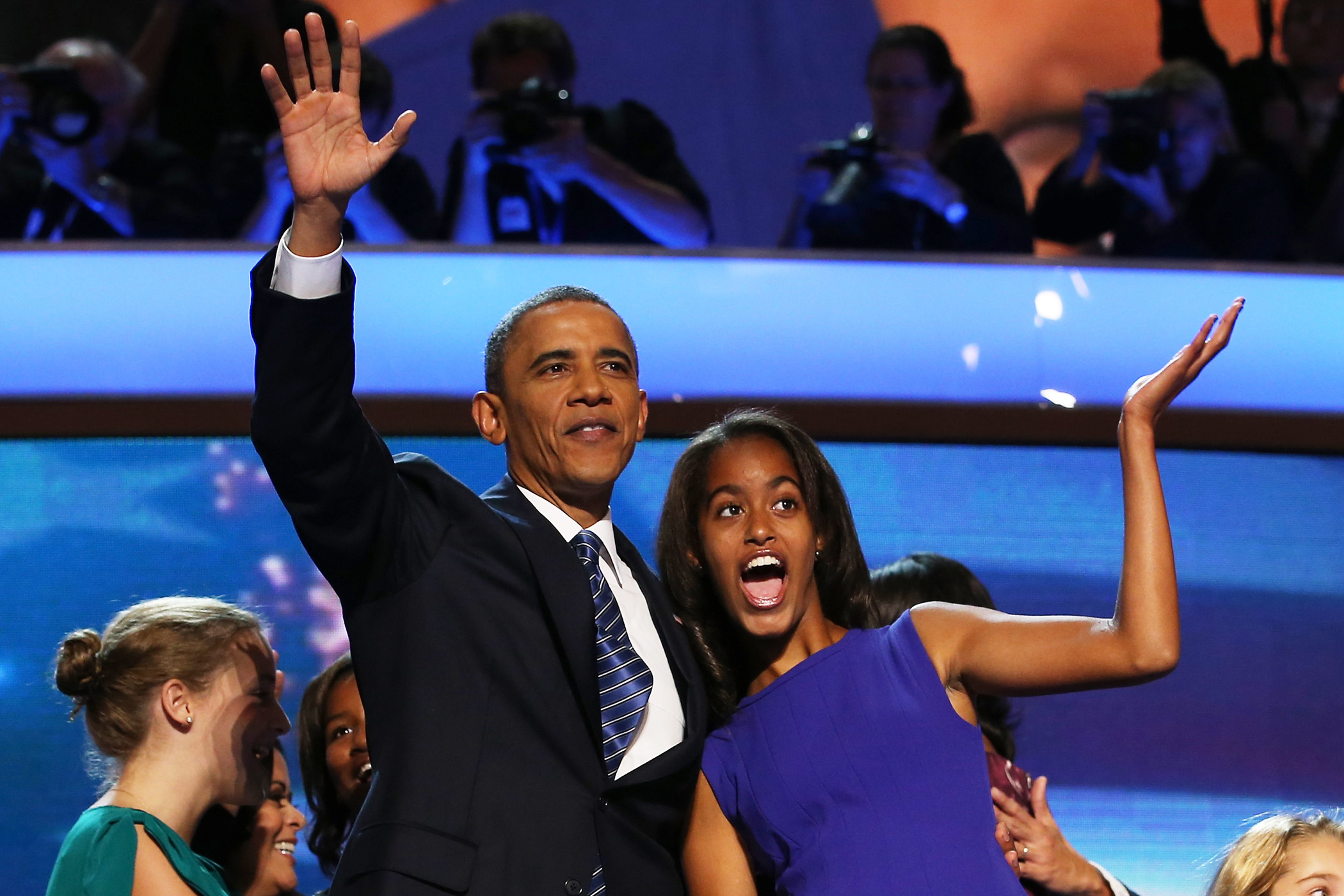 Sept. 6, 2012                                                              President Barack Obama waves on stage with daughter Malia Obama after accepting the nomination during the final day of the Democratic National Convention at Time Warner Cable Arena in Charlotte, N.C.