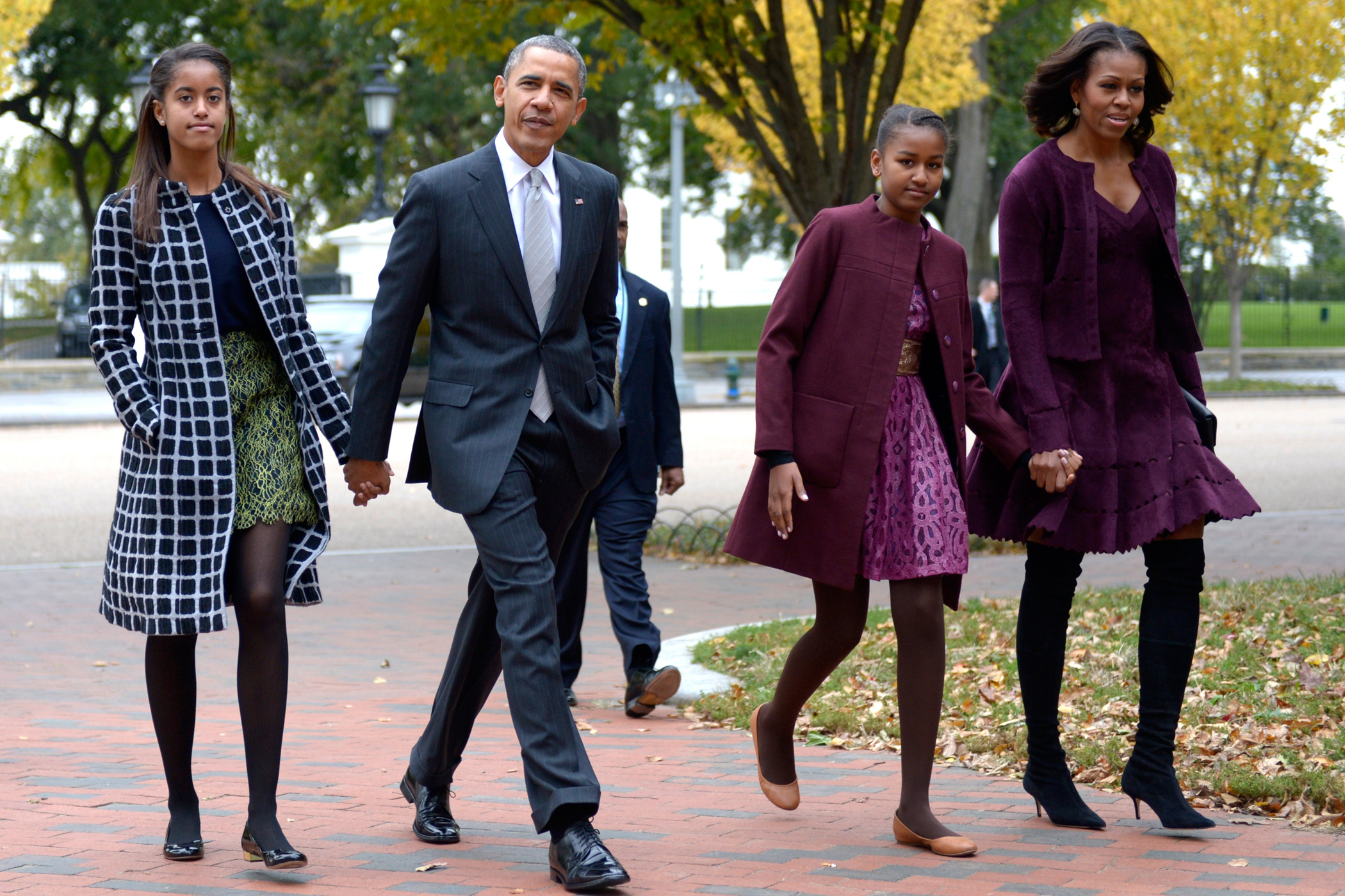 Oct. 27, 2013                               President Barack Obama walks with his wife Michelle Obama and daughters Malia Obama  and Sasha Obama through Lafayette Park to St John's Church to attend service in Washington.