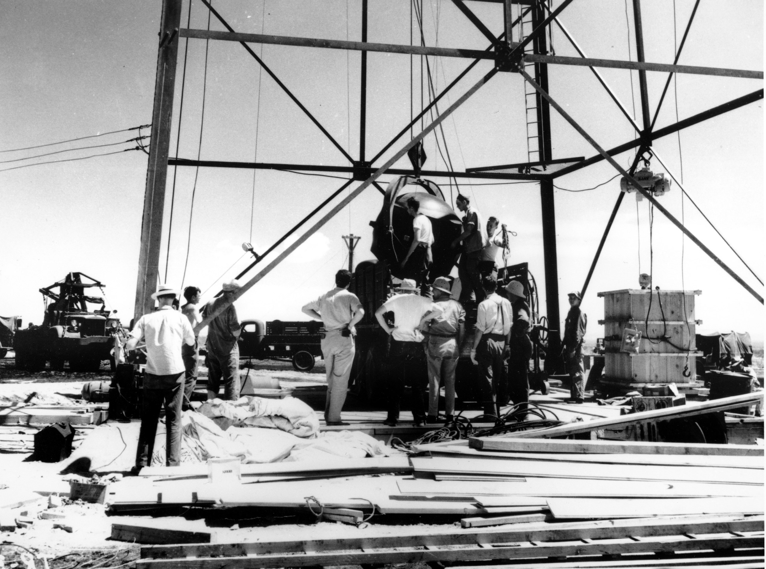 Scientists and workmen rig the world's first atomic bomb to raise it up into a 100-foot tower at the Trinity bomb test site in the desert near Alamagordo, N.M. in July 1945. The first atomic bomb test, known as the Manhattan Project, took place on July 16.