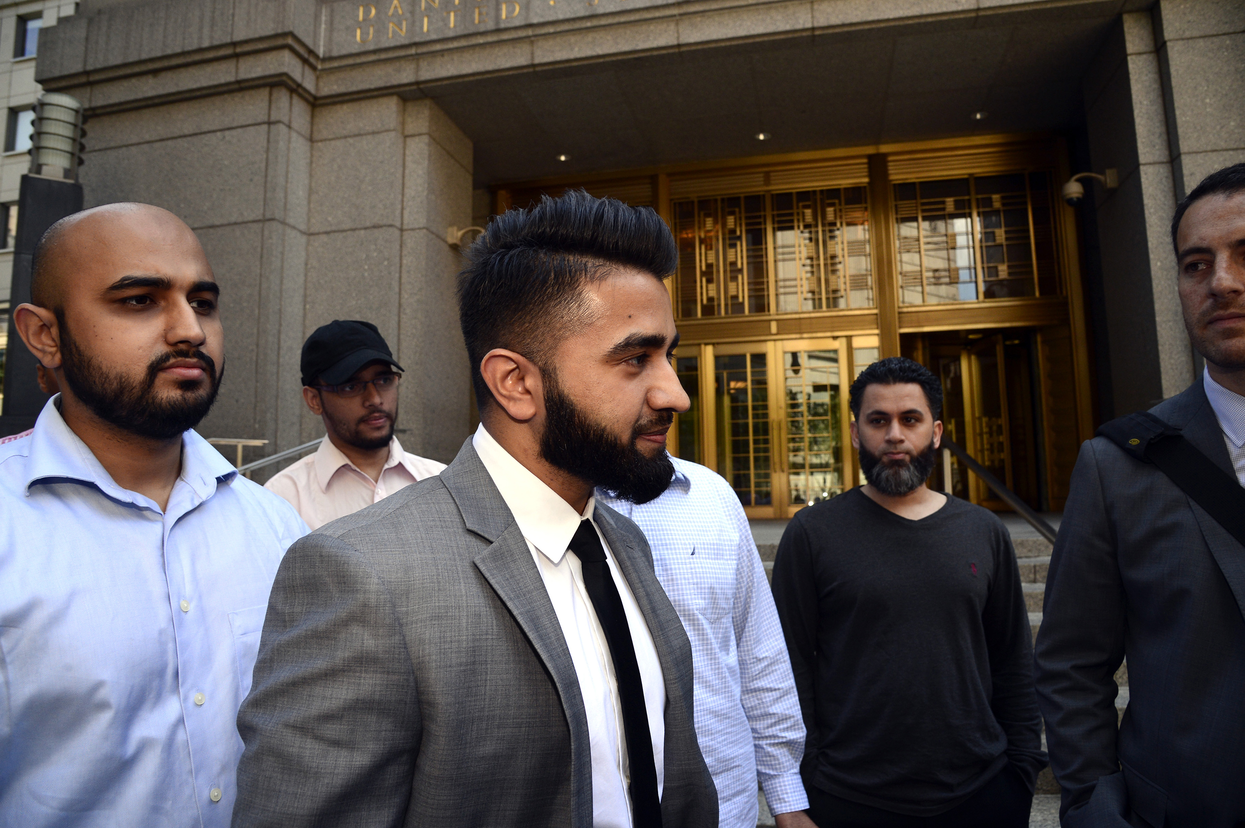 New York Police Department officer Masood Syed, center, leaves Manhattan Federal Court on June 22, 2016. Sayed, a Sunni Muslim, filed a lawsuit against the city for suspending him from the force over the length of his beard.