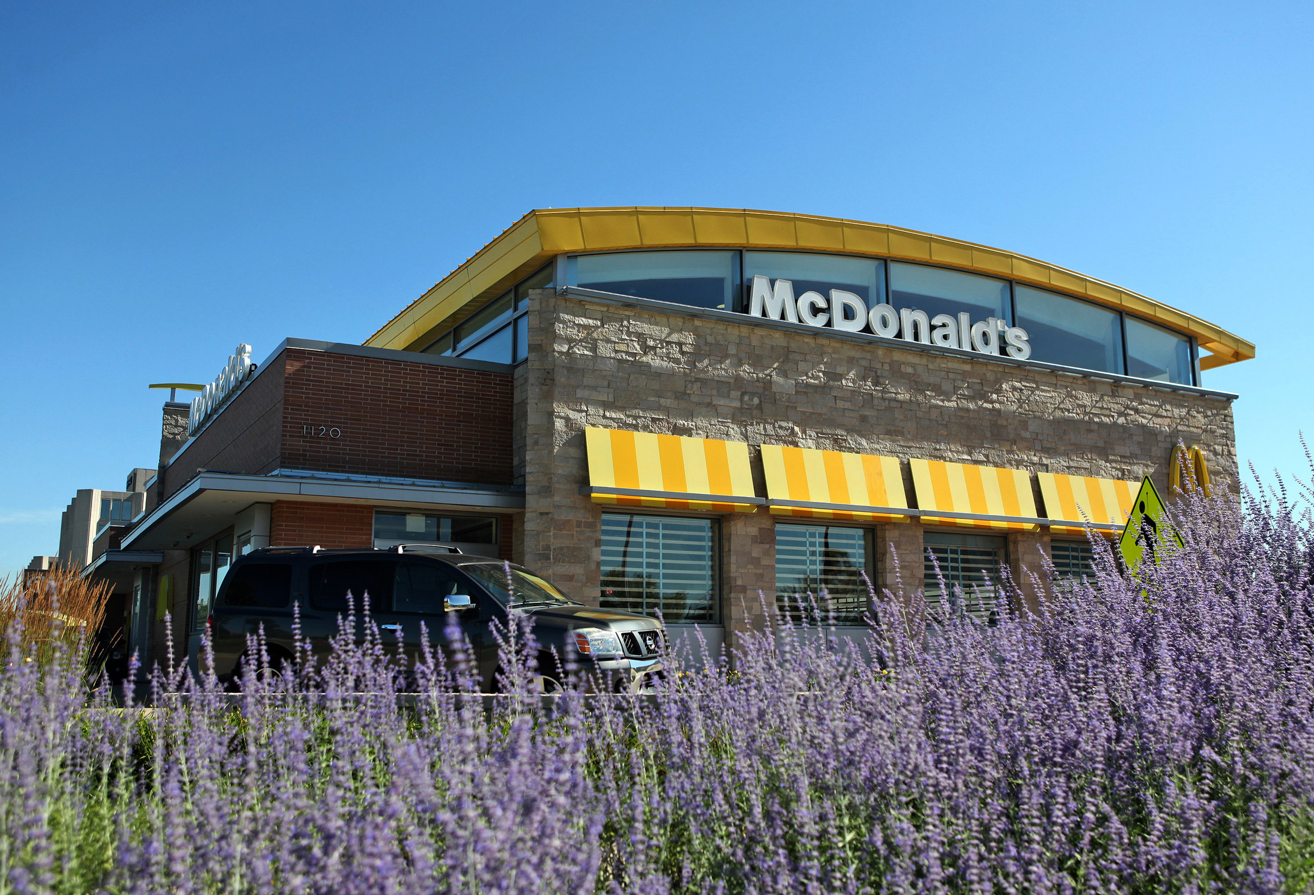 A car passes in front a McDonald's Corp. restaurant in Oak Brook, Illinois, U.S., on  July 12, 2013.