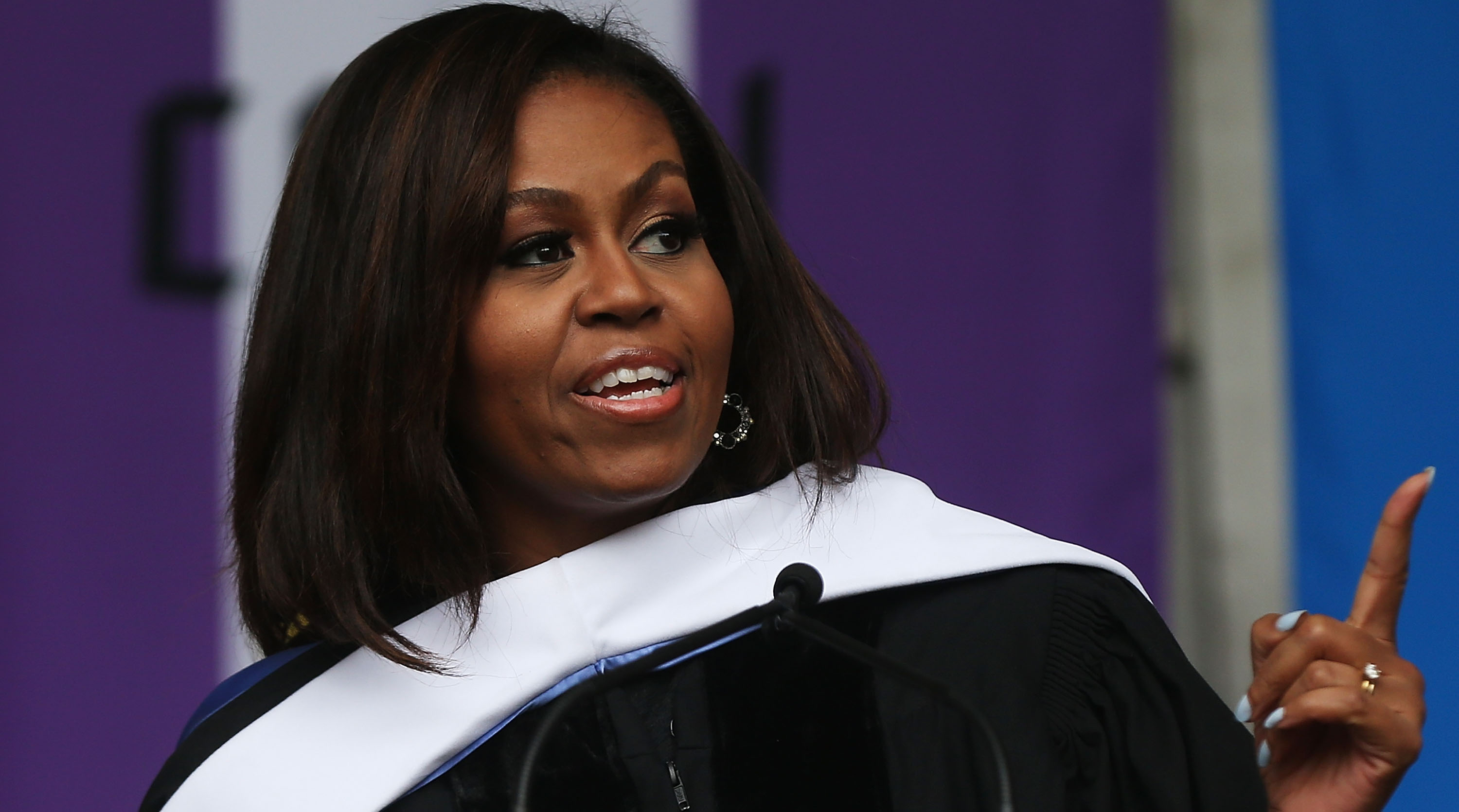 Michelle Obama delivers the commencement speech after being presented with an honorary doctorate of humane letters at City College in New York City on June 3, 2016.