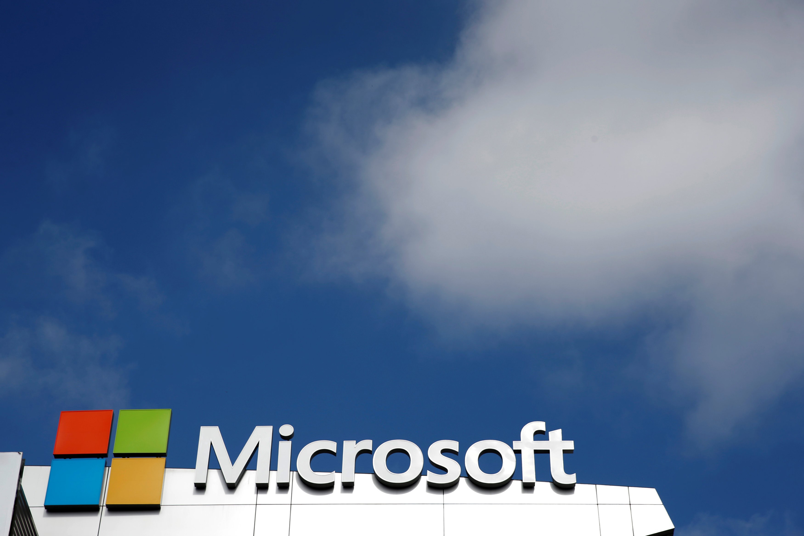 A Microsoft logo is seen next to a cloud the day after Microsoft Corp's $26.2 billion purchase of LinkedIn Corp, in Los Angeles on June 14, 2016.