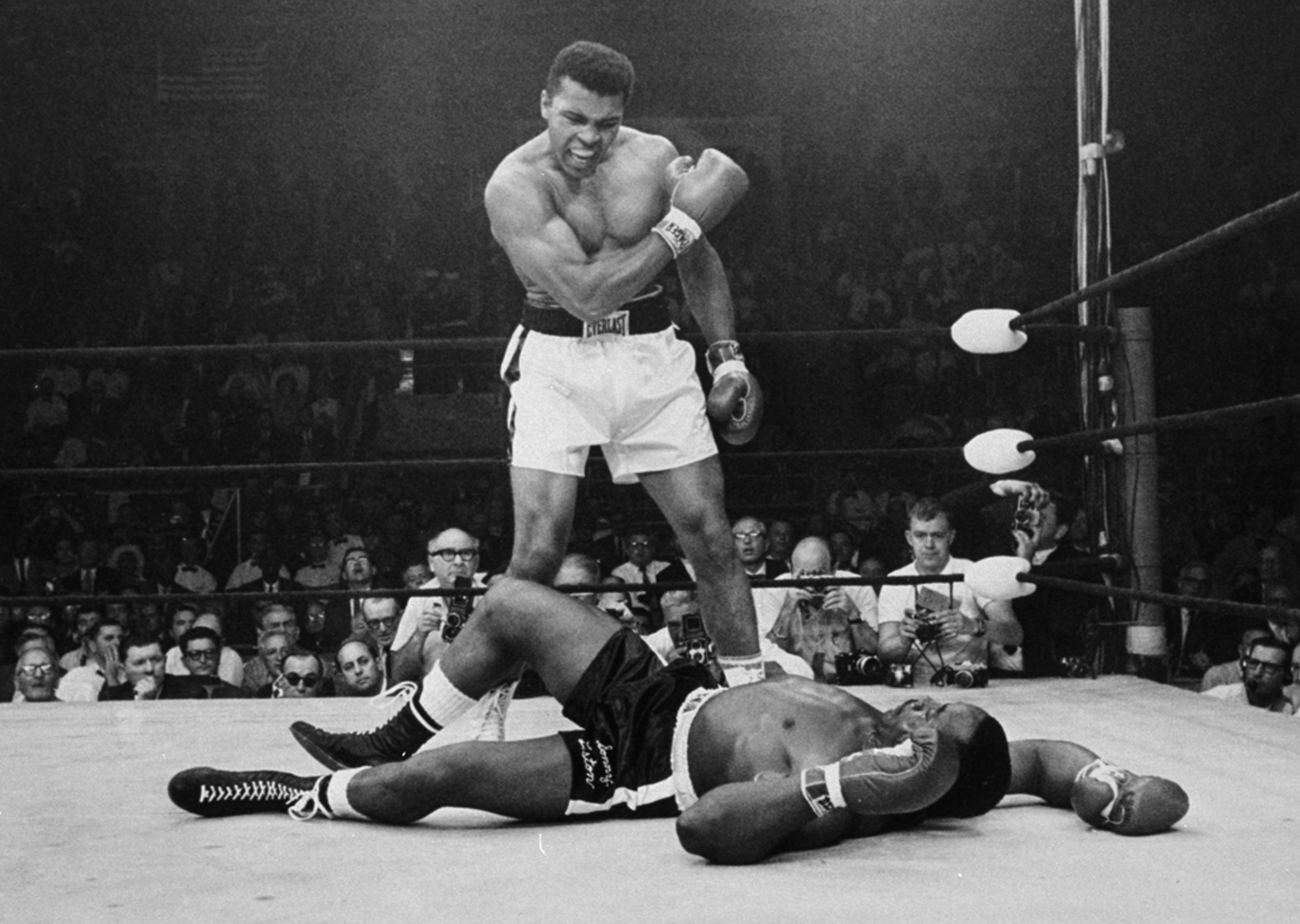 Heavyweight champion Muhammad Ali stands over fallen challenger Sonny Liston in Lewiston, Maine, on May 25, 1965.