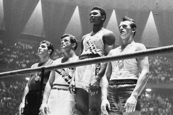 Muhammad Ali, second from right, and the winners of the 1960 Olympic medals for light heavyweight boxing on the winners' podium in Rome.