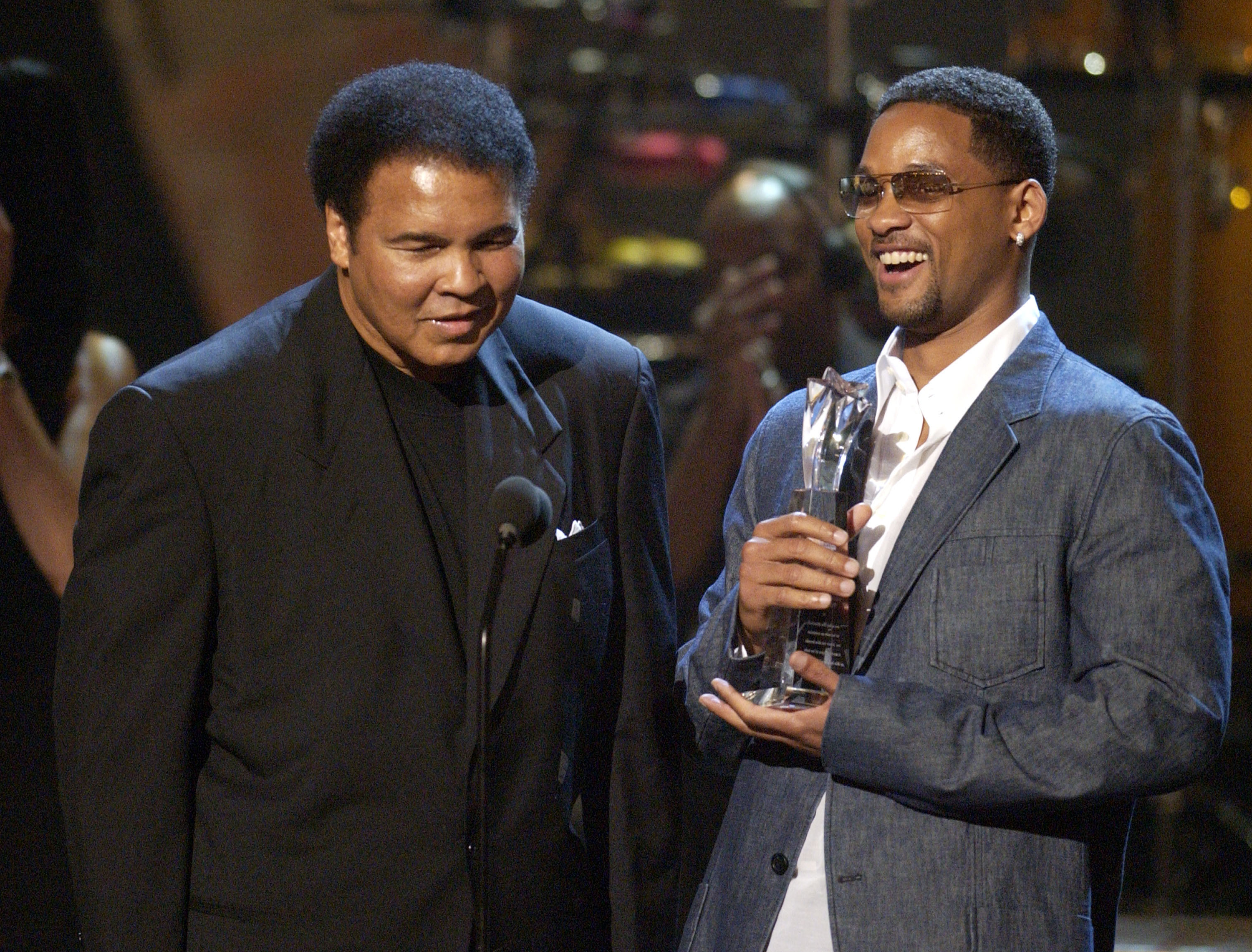 Muhammad Ali accepting his Humanitarian Award from presenter Will Smith during the 2nd annual BET Awards in Los Angeles on June 25, 2002.