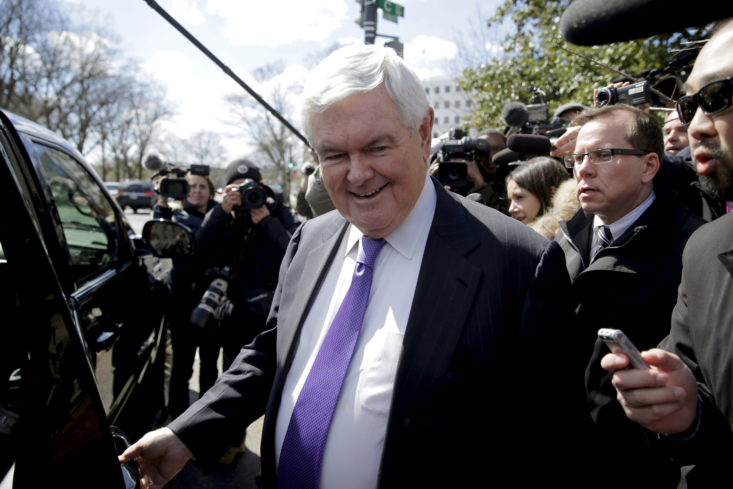 Newt Gingrich is followed by the media as he walks from a meeting with Republican presidential candidate Donald Trump in Washington, March 21, 2016.