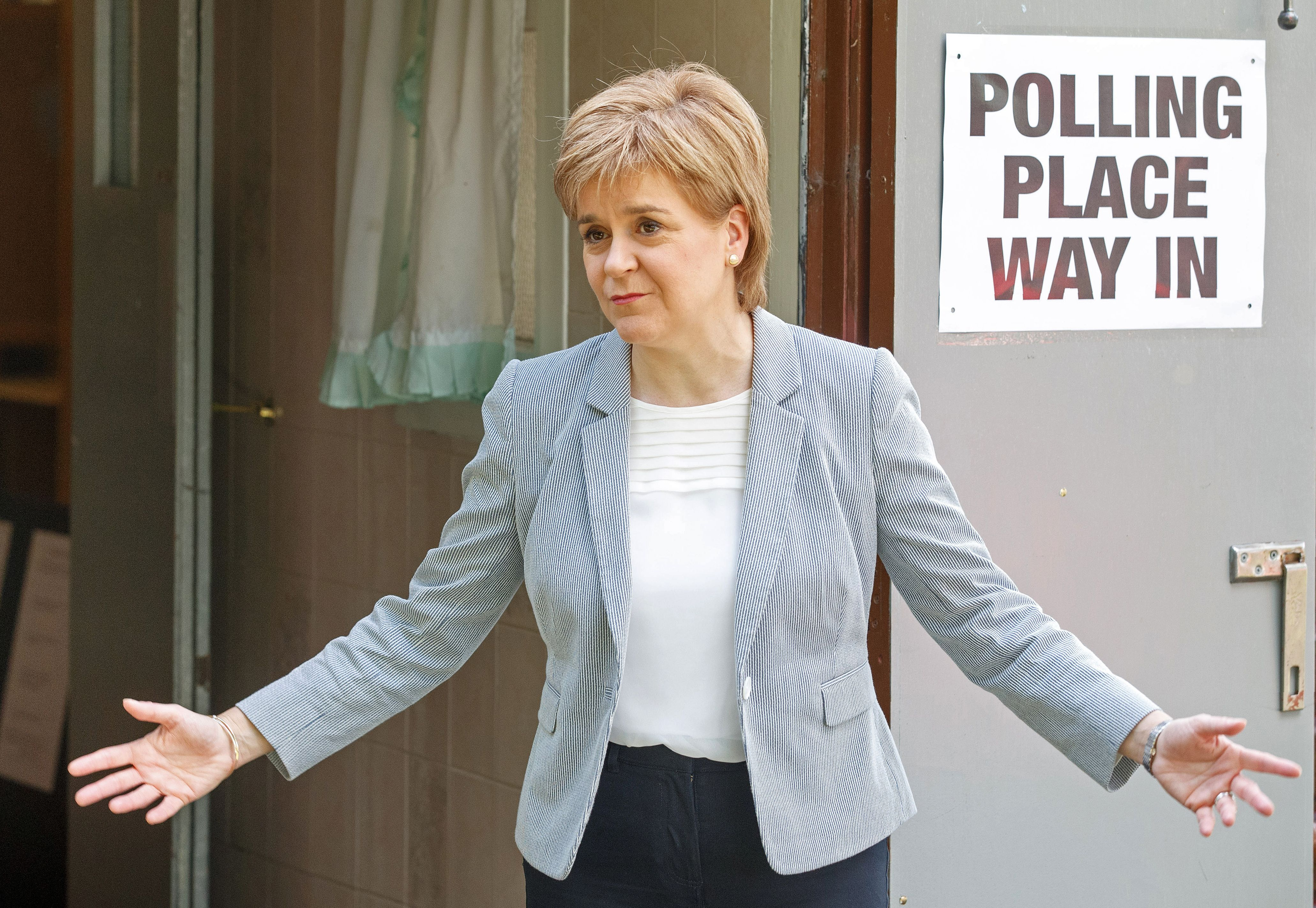 Scotland's First Minister and Leader of the Scottish National Party (SNP), Nicola Sturgeon, reacts as leaves after voting at a polling station at Broomhouse Community Hall in east Glasgow, on June 23, 2016.