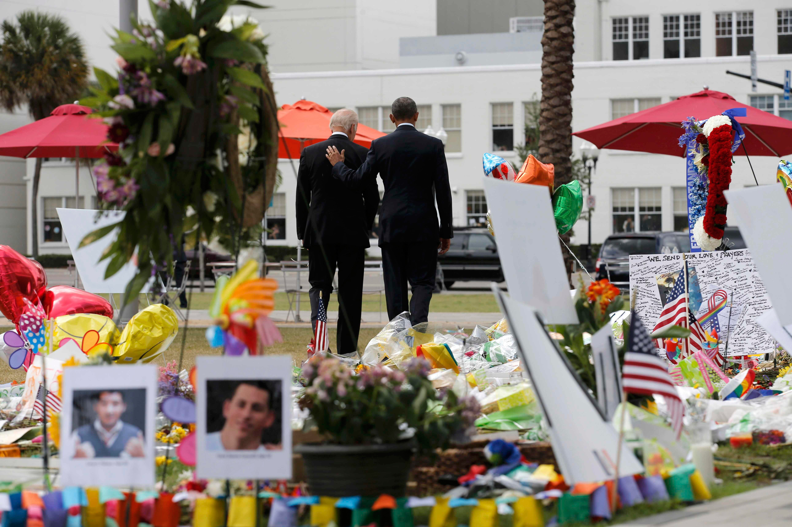 President Barack Obama and Vice President Joe Biden depart a makeshift memorial after placing flowers in memory of shooting victims of the massacre at a gay nightclub in Orlando, Fla., on June 16, 2016.