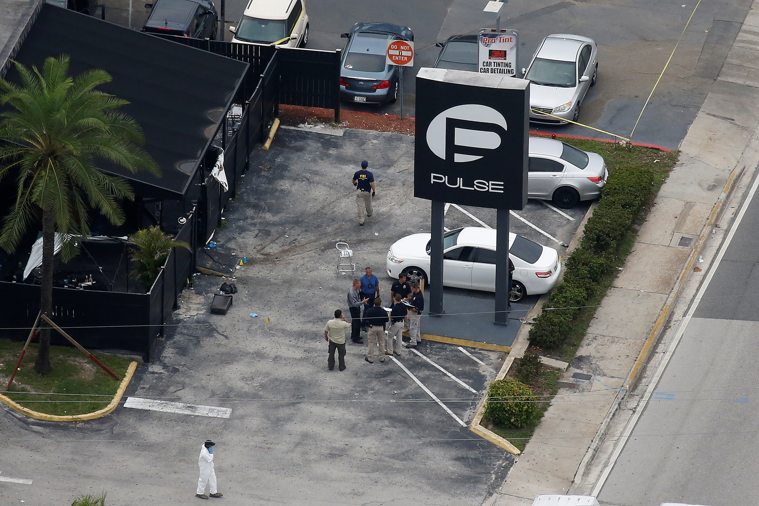 Investigators work the scene following a mass shooting at the Pulse gay nightclub in Orlando, Fla., on June 12, 2016.