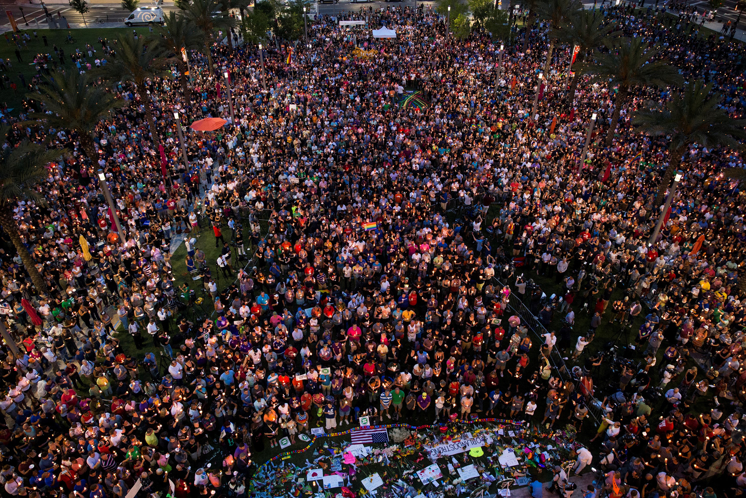 Thousands gather at the Dr. Phillips Center for the Performing Arts to pay their respects for those lost in the Pulse nightclub shooting in Orlando on June 13, 2016.                                                                Candlelight vigils and remembrances for the victims of the shooting at Pulse, a gay nightclub in Orlando, Florida. Early Sunday, an American-born man who had recently pledged allegiance to ISIS opened fire in the nightclub killing at least 49 people, in the worst mass shooting in U.S. history.