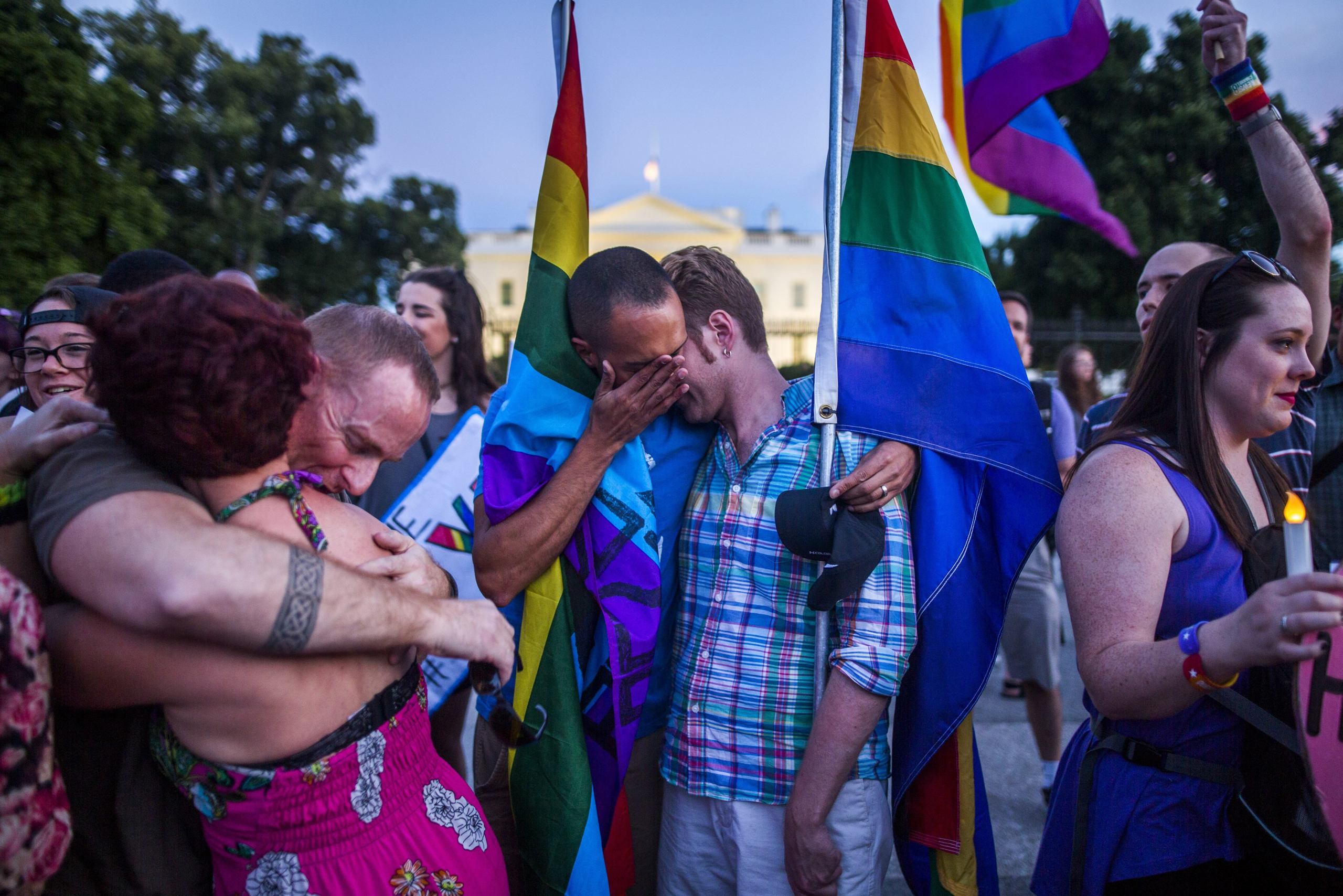 Members and supporters of the LGBT community attend a candlelight vigil outside the White House in Washington, D.C. on June 12, 2016.